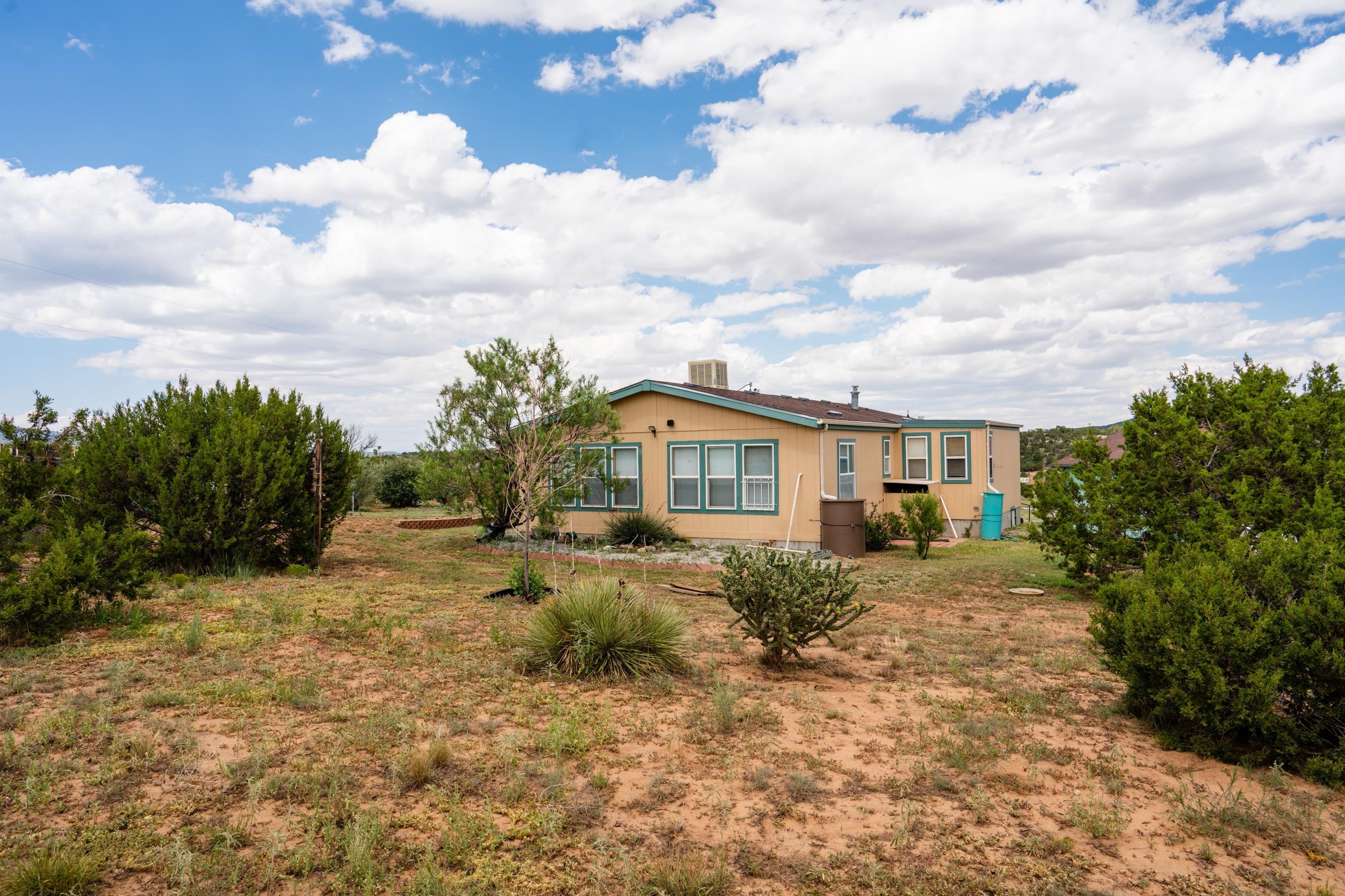 Come see this beautiful 2.25 acre property nestled in the heart of Sandia Crest. This well maintained manufactured home features a spacious living area and kitchen, two bedrooms, two full baths, a 24'x24' detached garage, and sits on a permanent foundation. Enjoy your morning coffee to incredible views of the Sandias. Schedule a showing today!