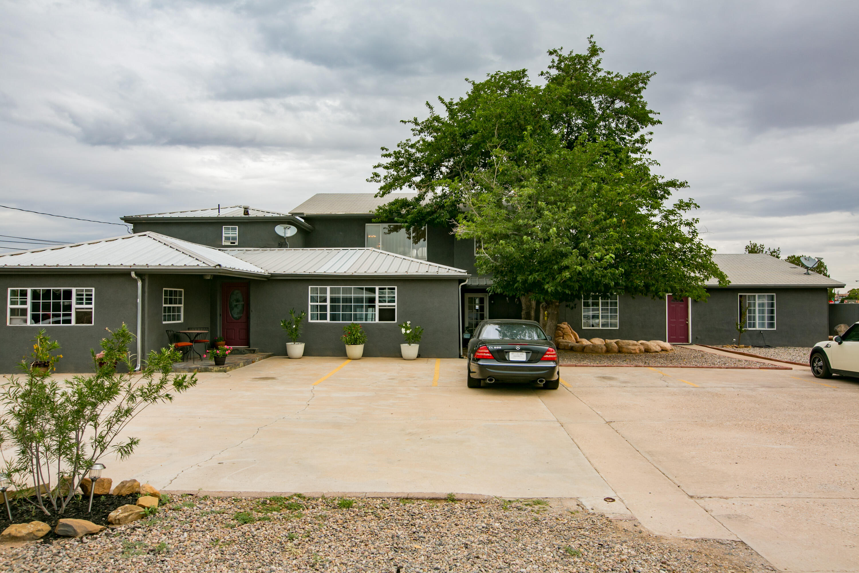 Open house this Wednesday 10/20 4-6 pm. Price Reduced, Offer Now! This gated estate, located in the North Valley, offers endless opportunities. Recently updated home has 8 bedrooms, 5 bathrooms, office, and multiple living areas and is perfect for a large, extended family (with in-law quarters) or multi-generational living.  Possible income producer (bed and breakfast, AirBNB, home sharing site, vacation rental site, assisted living, or group home).  Close to restaurants and breweries.