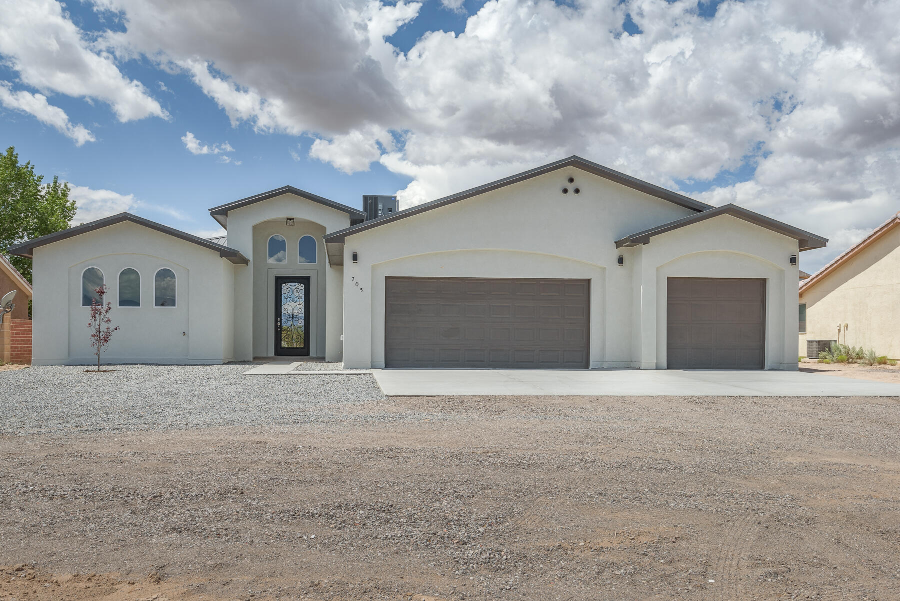 Spectacular, custom new build on 1/2 acre in Rio Rancho Estates! Be greeted by a custom wrought-iron privacy door & vaulted ceiling in the foyer. The open concept living/dining/kitchen area is adorned w/ natural light from the picture-frame windows. Chef's Kitchen boasts a large island, ebony granite, farm sink, designer backsplash, SS appliances, stacked cabinets, & large pantry. Split BR design allows for privacy in the MBR which has His/Hers closets & vanities, custom soaking tub & barn-style shower glass door. BR's 2&3 share a Jack-n-Jill. Powder bath for guests. Utility room w/lav sink. Finished 3 car garage. Plank tile thru-out w/carpet in BR's. Huge covered back patio. Metal roof will last! BACKYARD ACCESS & VIEWS!