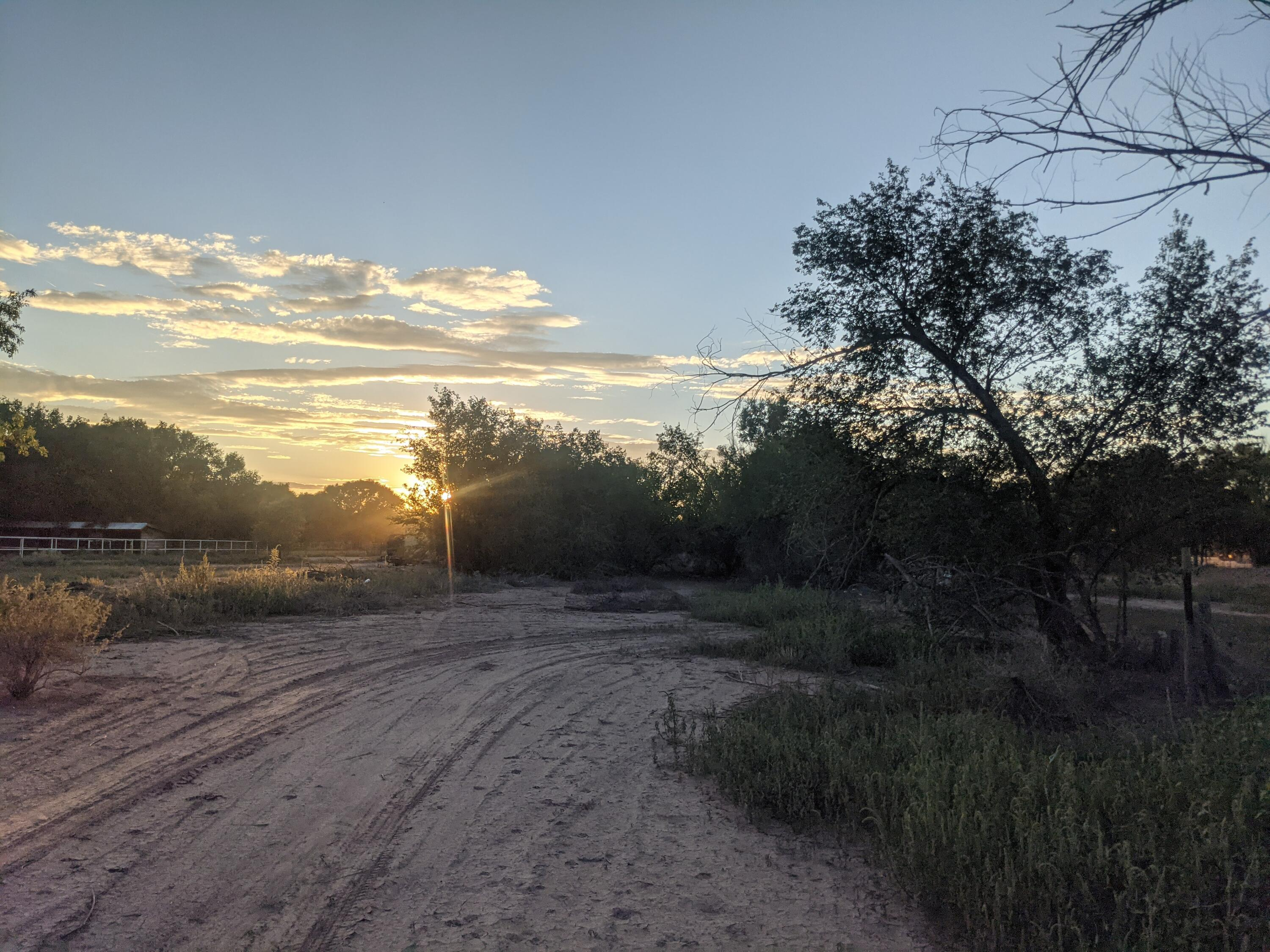 Great opportunity to own a piece of Corrales on Corrales Road! Views of the Sandia Mountains! Property sold as-is, where-is with no warranties expressed or implied. Do not enter home or buildings. Call your agent for more information or questions.