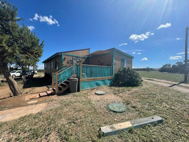Wonderful home in the heart of Edgewood! This home sits on 2.34 acres with majestic views of the Sangre de Cristo mountains.  horses permitted ,The large front deck provides great outdoor living space . large dining room has plenty of space for entertaining.  many upgrades .