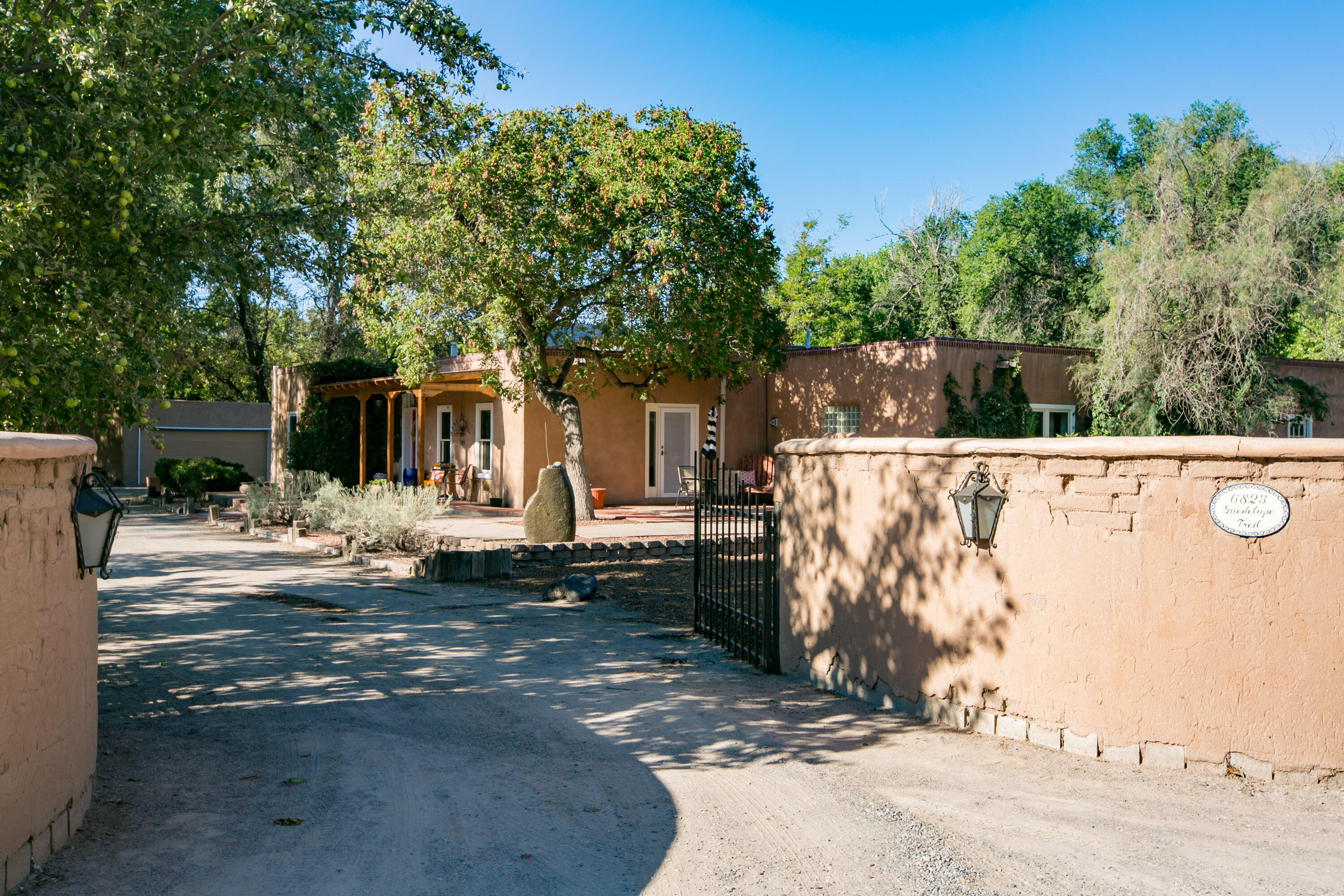 Have you been waiting for that quintessential North Valley adobe to call home?  Well, look no further!  This gorgeous 1.5+ acre property is nestled on a private lane in a verdant neighborhood just blocks from Rio Grande. Traditional NM architecture blends seamlessly with timeless artistic elements to charm you from start to finish.  Your guests will be greeted by a lovely sitting porch.  Light and bright, the warmth of this amazing home is felt throughout, from high ceilings accentuated by rough hewn beams to the brick and wood floors to the skylights and kiva fireplaces.  Kitchen boasts  wood cabinets, granite countertops, Viking gas stove with griddle and range hood, large breakfast nook plus a formal dining room with a kiva FP.  Gracious owner's suite ...(more)