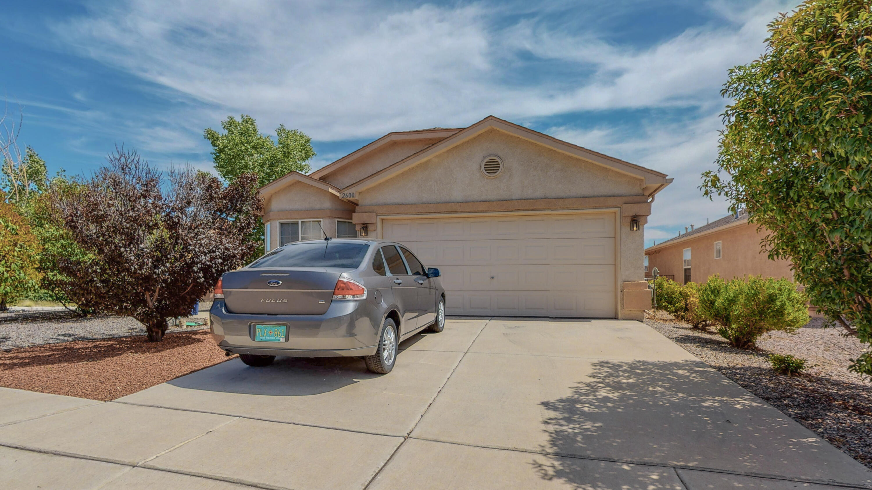 Stunning!  Rare single story home on a large corner lot now available!  Mountain VIEWS from the backyard!  Backyard access possible!  Open concept floor plan, vaulted ceilings, REFRIGERATED AIR, new water heater in 2021! Home features storm door at front entry, updated kitchen with new backsplash and new microwave, hallway wood accents, beautiful fully landscaped backyard with covered patio and painted concrete Must See!