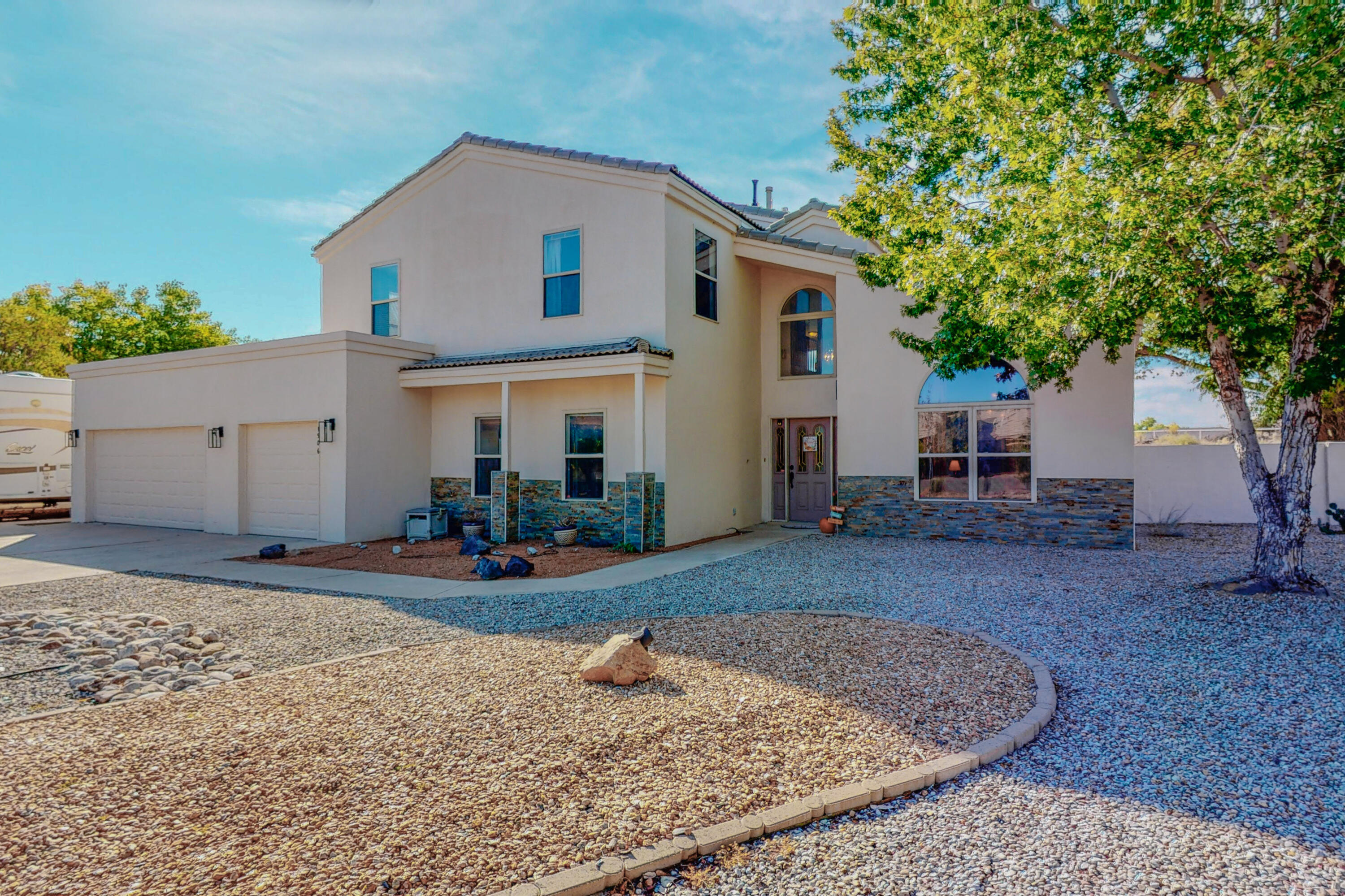 West River Beautiful 5 BR, 3BA in private Windmill Estates.  Open floor plan with Living/Dining combo, family room, plus sunny bonus room perfect for home office, playroom, or gym.  Kitchen w/island, large pantry, updated stainless appliances, and nook.  Spacious Owner's suite offers large walk-in closet, private office/sitting area, double sinks, & jetted garden tub. Bedroom on main floor could serve as 2nd owner's suite or in-laws area. Huge 3/4 acre lot . Relax in the peaceful back yard with lush landscape, trex deck, flag stone patio, & new hot tub. The 3 car garage has extra storage, side RV parking/hookup, plus storage shed. Recent updates include stucco, stacked stone accents , decking and roof. The possibilities are endless!   File opened @ Stewart Title, Monica Borrego.
