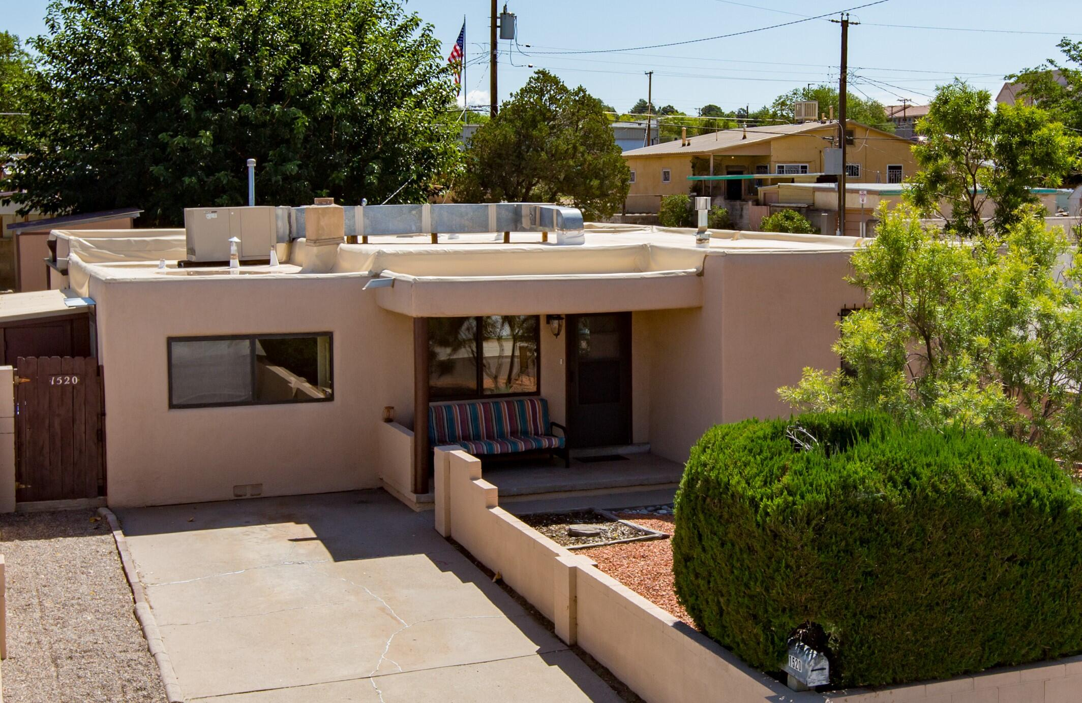 UNM Home for Sale! Move in Ready. LOCATED Near UNM Football Stadium and Isotopes Park. Rare UPDATED 5 Bedroom home with 2 Baths, Large Living Room in front and Family Room at the rear. All New Flooring. Fully landscaped with Tree shaded backyard. Newer roof, stucco, gutters and electrical panel. Kitchen Updated with appliances, counter tops, flooring and painted cabinets. Baths Updated with flooring, shower surround and fixtures. Your buyers will love it.