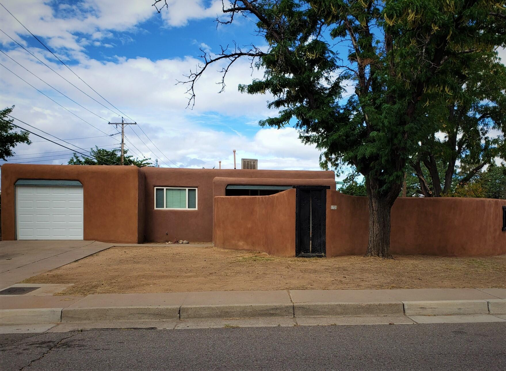 Darling 3 bdrm, 1.75 ba., 1 cg  with mountiain view in perfect location! Blocks from Uptown/Trader Joes, quick commute to Kirtland AFB or I-40 access.Sandia High area. Freshly painted, ceramic tile thruout, except carpet in bdrms. Nice condition, ready to move in. Spacious living room, large open kitchen with  dining room. Gas stove. Master bdrm. has french doors to huge open patio and 3/4 bath. Large lot has charming courtyard front entry and  privacy block walls surrounding.  Large garden/ lawn areas with auto sprinklers. If you want  to raise your own produce or have a spectacular outside living area, this is the place! Oversized 1-car garage with room for your work area or storage. Small storage  bldg. in back.Grab this one! It's going!!