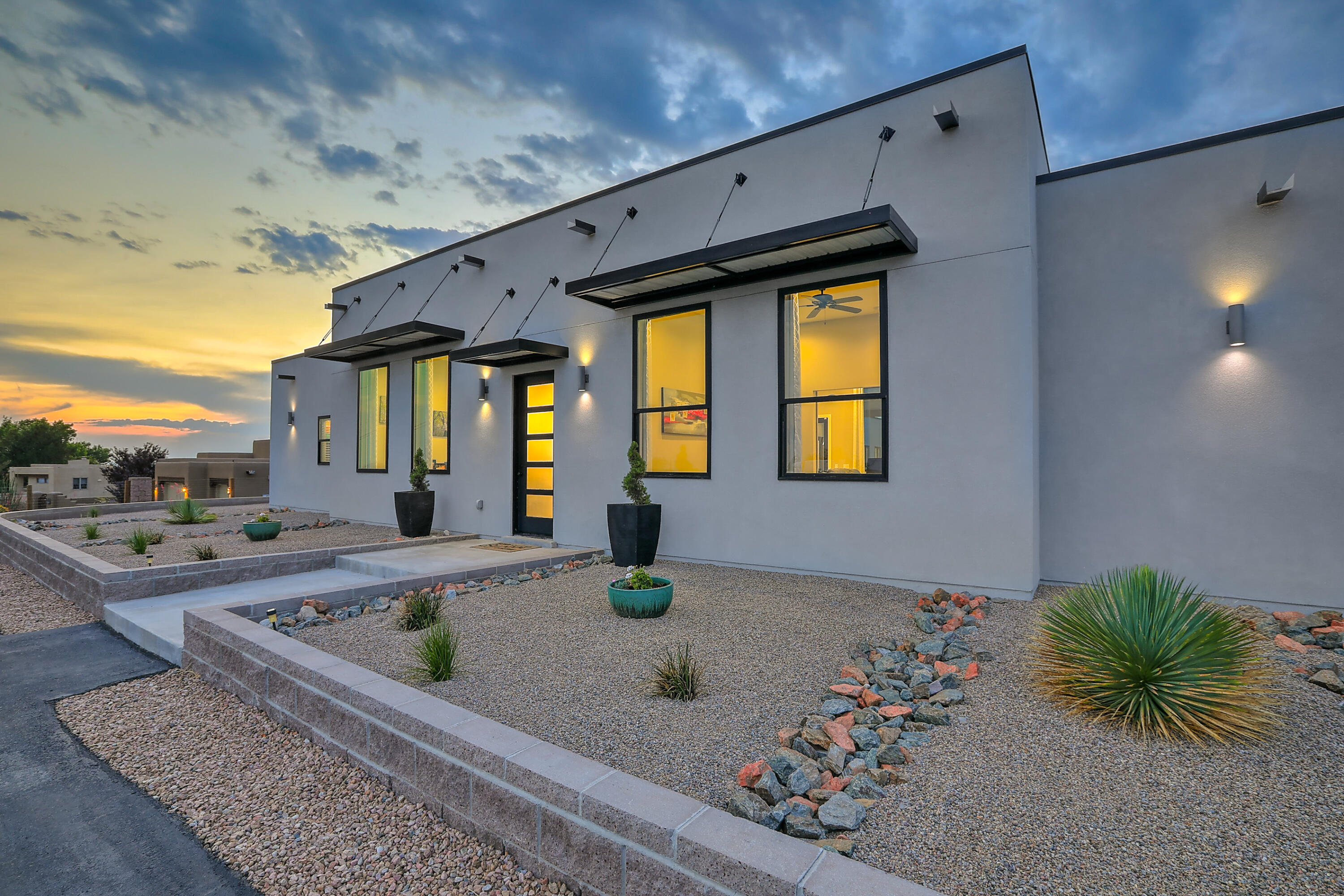 This thoughtfully designed contemporary custom home was built in 2019.  You'll enjoy the light and bright floor plan which boasts the master suite, 2 other bedrooms, an office, a large theater room, an oversized 4 car garage AND an attached casita with a separate entrance, kitchen, and bathroom.  In the gourmet Kitchen you'll find luxury amenities like an oversized granite island with bar seating, custom cabinetry, double stove and ovens with 10 gas burners, oversized stainless steel refrigerator and freezer and an open concept. In the master there are 2 large walk in closets, double sinks, separate tub, and a custom tile designed walk in shower. The plush backyard has a covered patio with tile flooring, grass, a dog run, and a refreshing pool with incredible views of the Sandia Mountains!