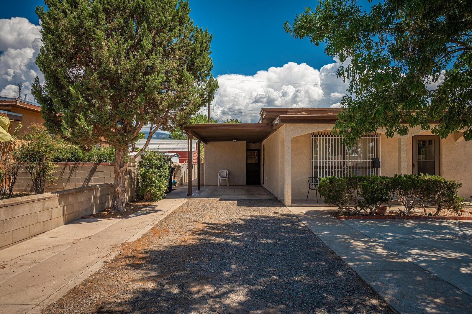 This lovely pueblo style home is ready for a new owner!The house features a spacious living room, cozy wood burning fireplace, breakfast nook, a formal dinning area and a sunroom for hobbies or entertainment.
