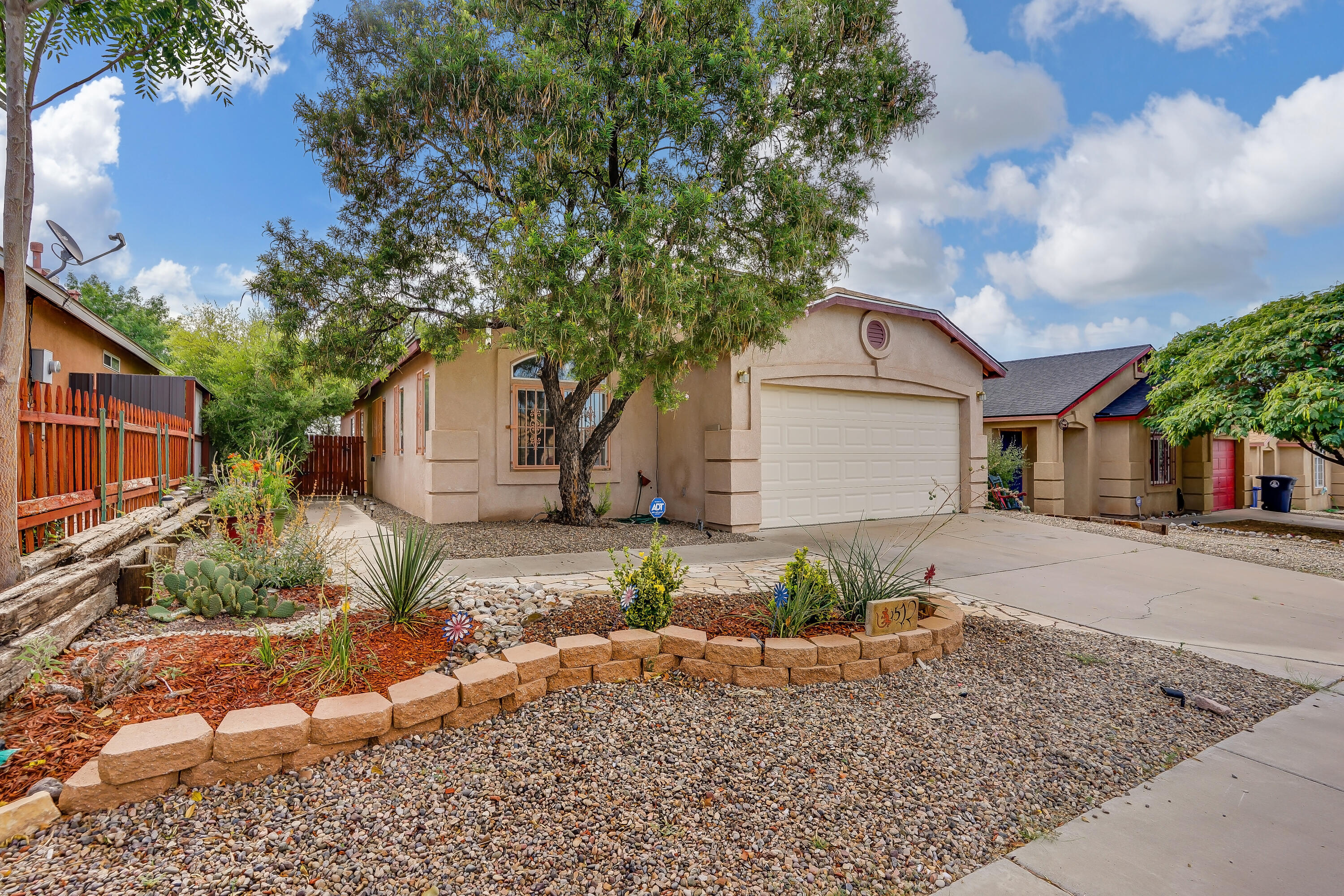 This freshly painted move-in ready home boasts an open floor plan, nichos, arched doorways and cathedral ceilings that provide a large living space. Separate family room area has french doors that open up to the beautifully landscaped and easy to care for backyard. The kitchen w/wrap-counter has plenty of cabinets for storage. The spacious master suite & master bathroom w/walk-in closet, double-sink vanity, separate shower and garden tub. New roof was installed in 2017 and the swamp cooler was replaced in 2019. You won't want to miss this one; make an appointment to see it today!