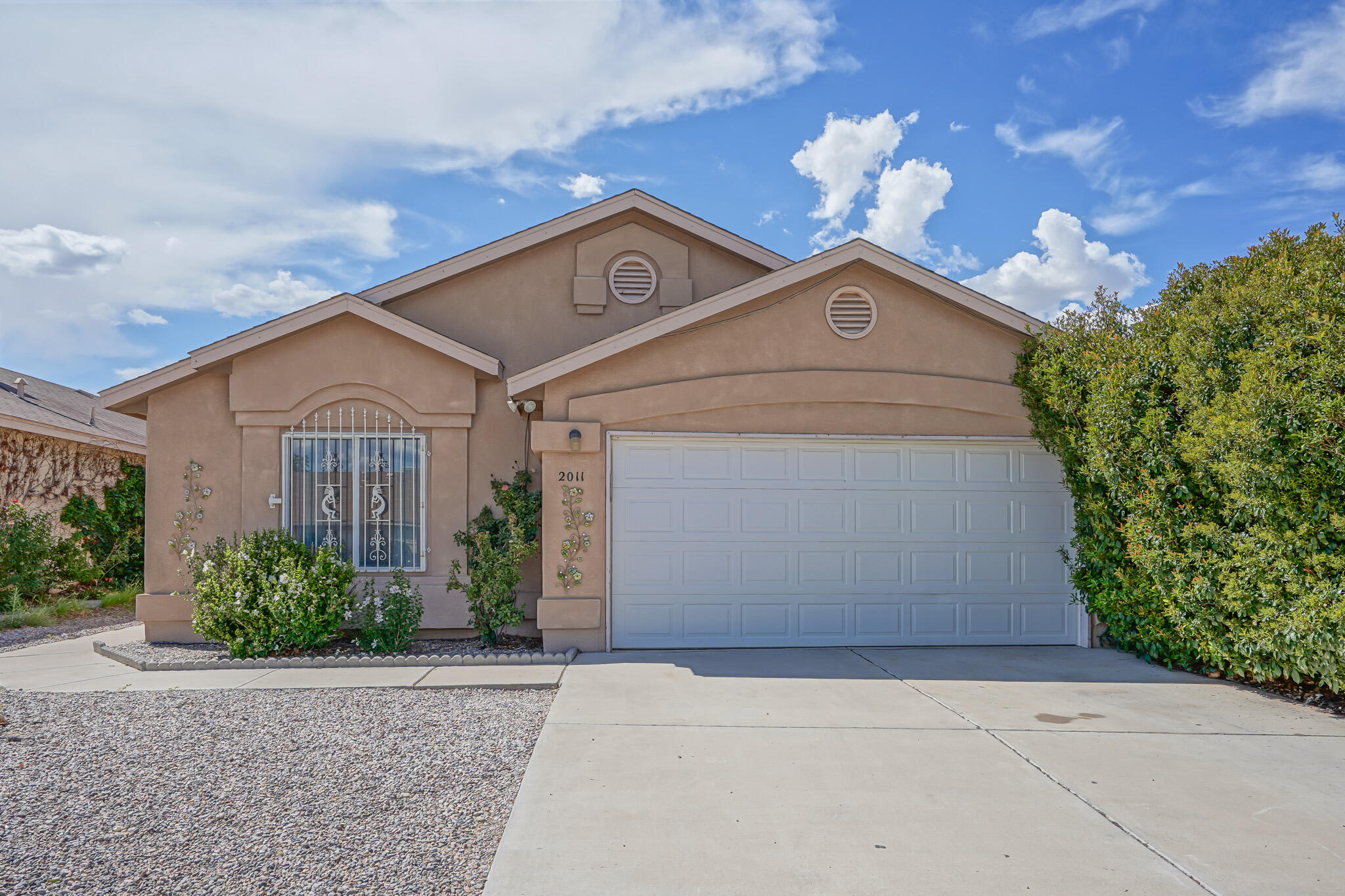 Welcome to this immaculately cared for 3 bedroom 2 bathroom fully remodeled home in the SW area.  The living area is complete with modern grey tile, trendy colors, fireplace  and vaulted ceiling.  The Kitchen is open, roomy and has beautiful modern black appliances.  Each bedroom is large with plenty of room for activities and storage.  The back yard is fully landscaped and complete with a full patio area.  Don't miss your chance to own this perfectly cared for updated home!