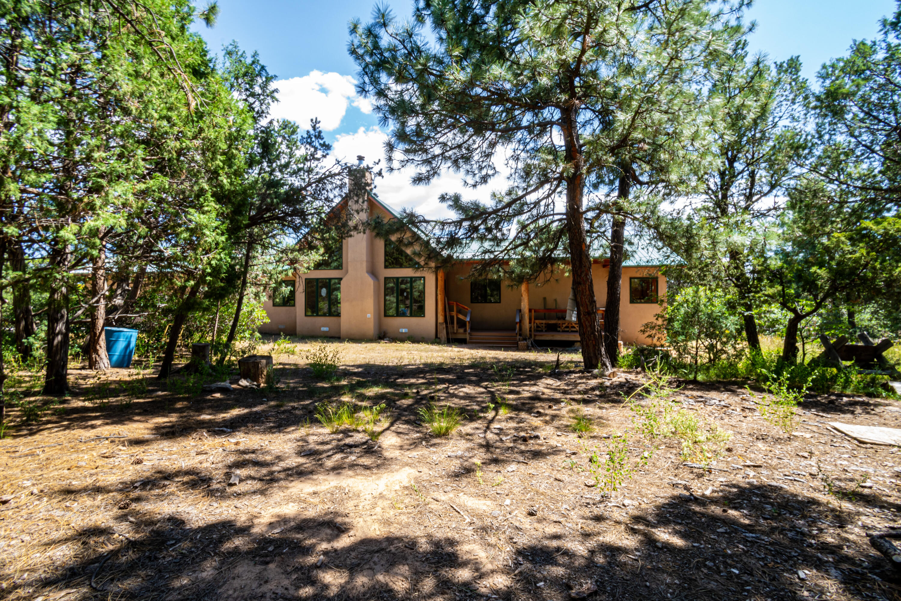 One of a kind Custom home nestled among the pines, gated community, lots of natural light, granite counter tops, central vac, custom fireplace to keep you warm on those cold nights. Great deck to enjoy nature views. Custom cabinetry throughout, 2 large closets in master, one is lined with Cedar, slate tile and hardwood floors throughout. Price to sell quickly, don't miss this beauty.Property has a well that is currently dry. Seller has water hauled in.
