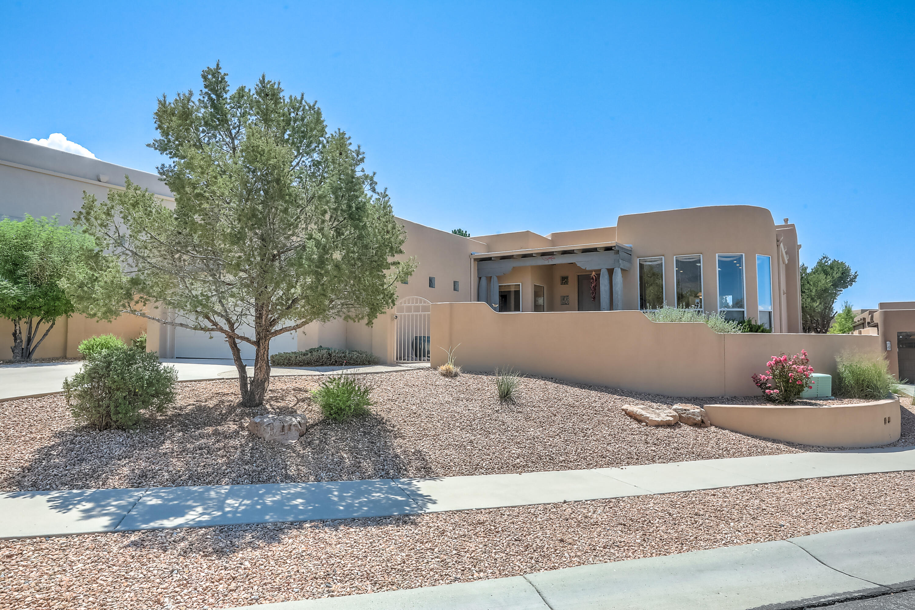 This beautiful Scott Patrick home in High Desert is absolutely spectacular and needs to be seen! Natural light floods the interior through glass skylights that were installed in 2020 along with a new roof (also installed 2020). This single story custom home is situated on 0.25 acres and has plenty of space for everyone with 2900 sq ft of living area. Mountain views from the breakfast nook & a great entertaining space flows between the kitchen and living room for those large gatherings. The owner's suite has a separate tub and shower and big walk-in closet. Ample additional bedrooms and bathrooms for everyone; Jack & Jill bath for beds 2 & 3 or a guest room with 3/4 bath access. The tandem garage parking means you can fit 3 vehicles to optimize your use of space. Schedule a showing today!