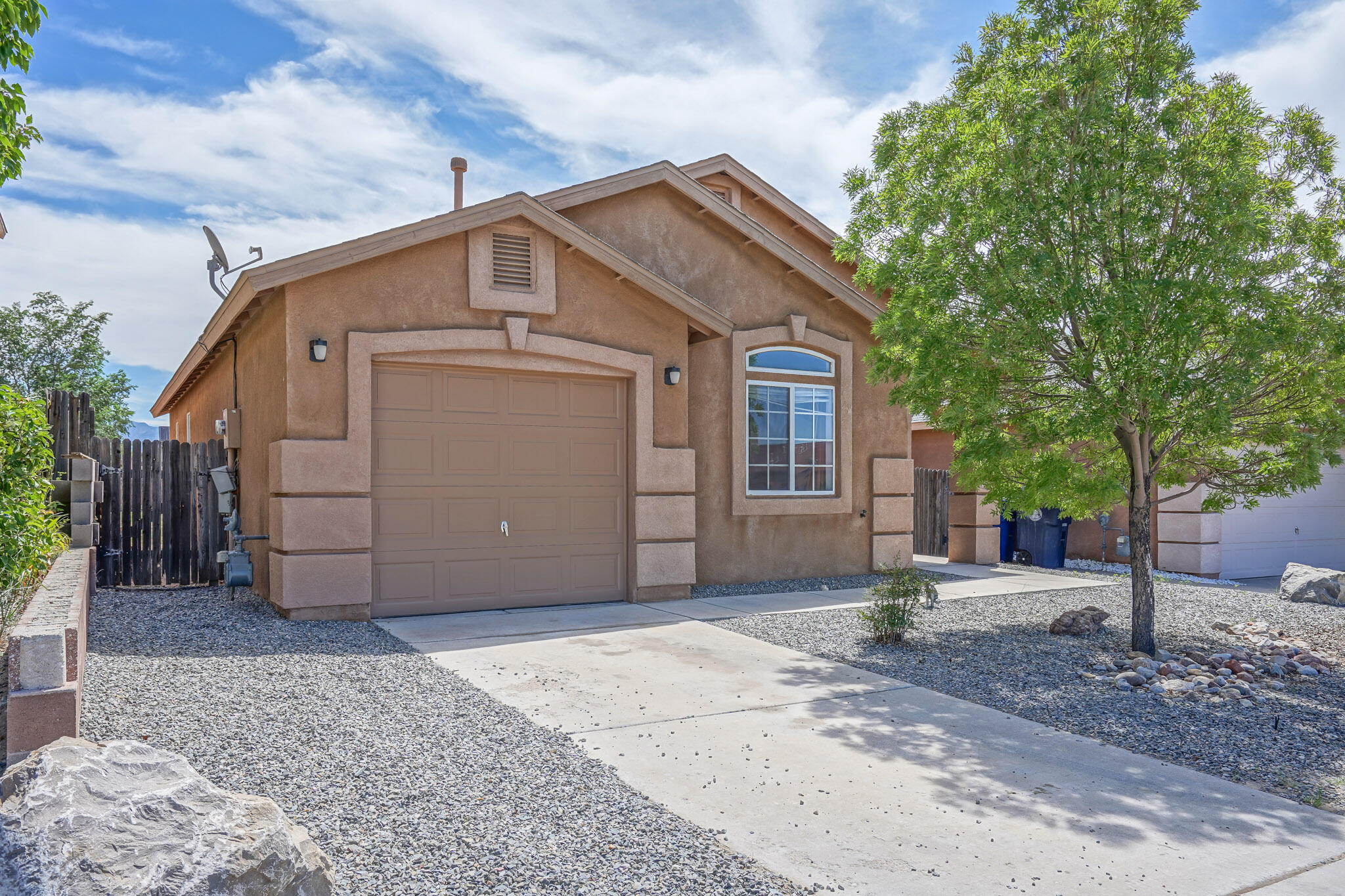 Dont miss this cute house on Albuquerque's west side! This perfect starter home features a large backyard, single car garage and two full baths! The Kitchen opens to the living room and is great for entertaining. This one won't last long!