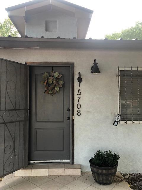 Beautiful home with half acre lot,  open floor plan, newer kitchen cabinets and appliances, new roof and stucco. New refrigerated system and newly remodeled bathroom. Backyard access, mature trees, horse stalls, large storage 16 x 16.