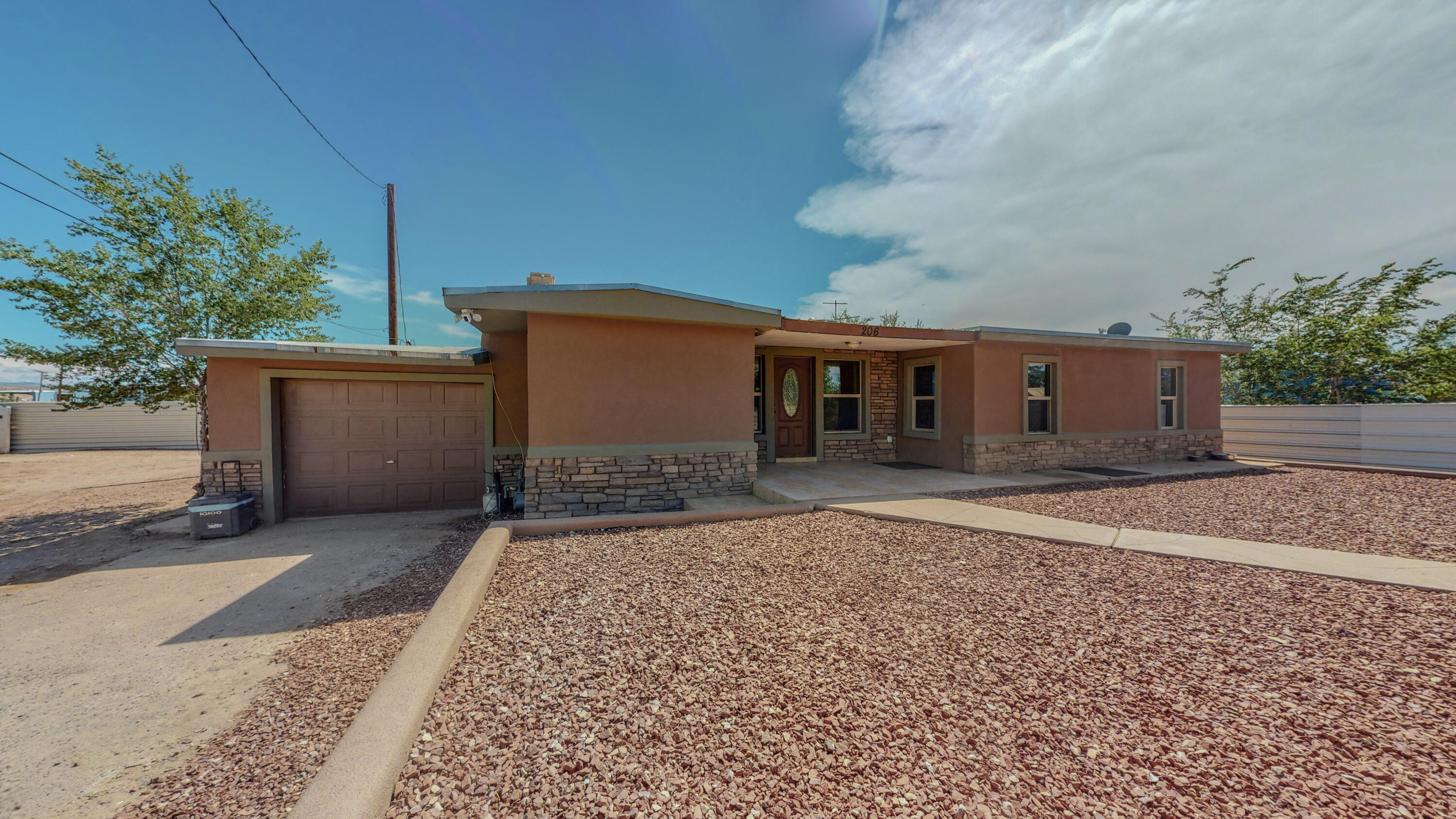 Bring Your Horses  and your Boy Toys, ,This home has refrigerated air, updated baths,  updated kitchen, two over-sized garages, one detached, one attached - double pane windows - wood burning fireplace plus wood stove - good size rooms - and lots of space to roam