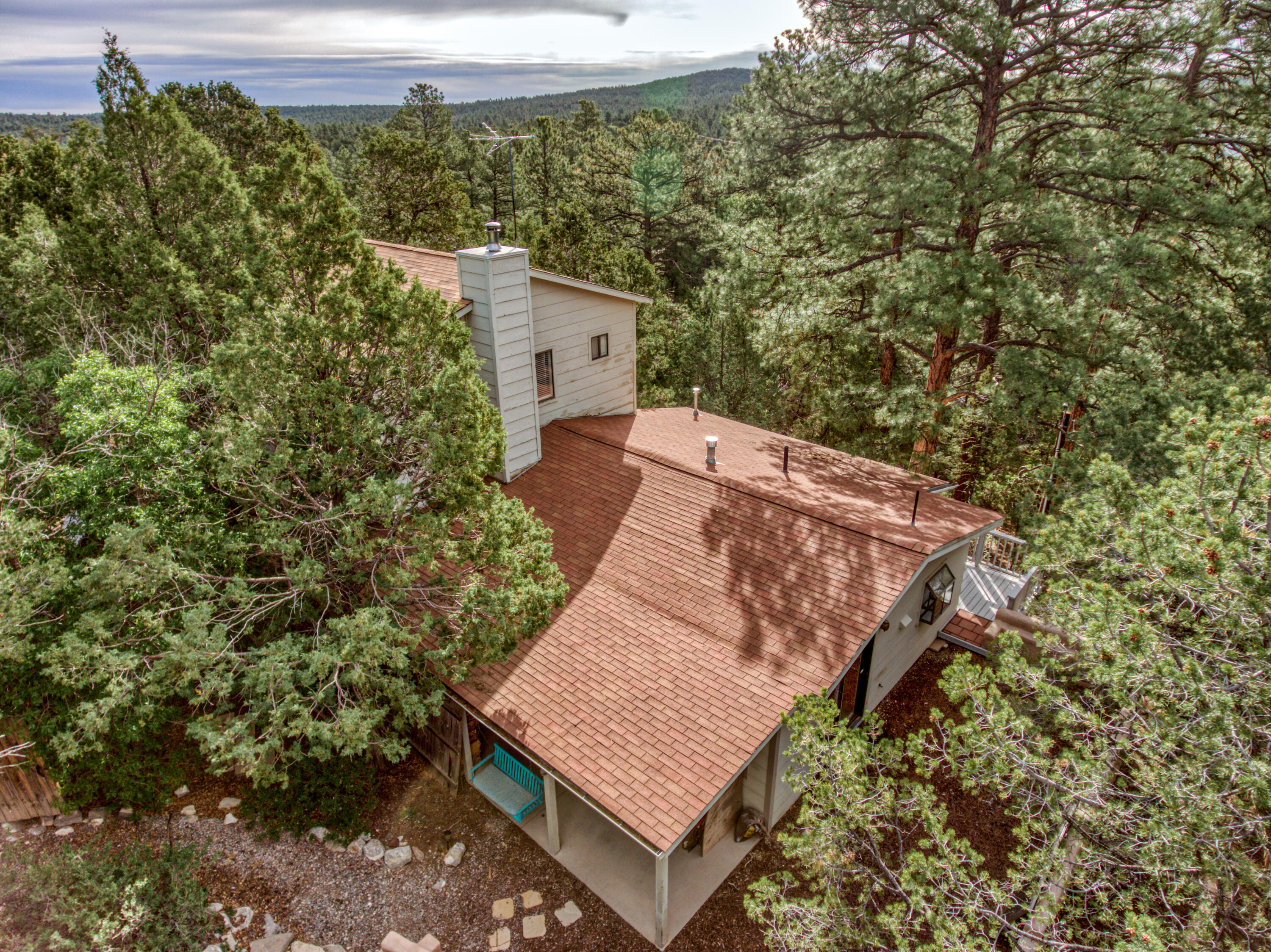 Welcome to the Ramblewood Subdivision in the East Mountain area! What a great place to call home and get away from city life. The property is beautiful with a variety of trees including tall pines. Enjoy sitting on your swing in your private courtyard. Theres plenty of room in the house which includes 3 bedrooms possible 4 and 3 baths. The appliances stay with the home. This home has an abundance of storage and recent improvements. There is a nice 2 car detached garage with 220 power & 30 amp service for an RV. Don't let this home get away it won't last long on the market.
