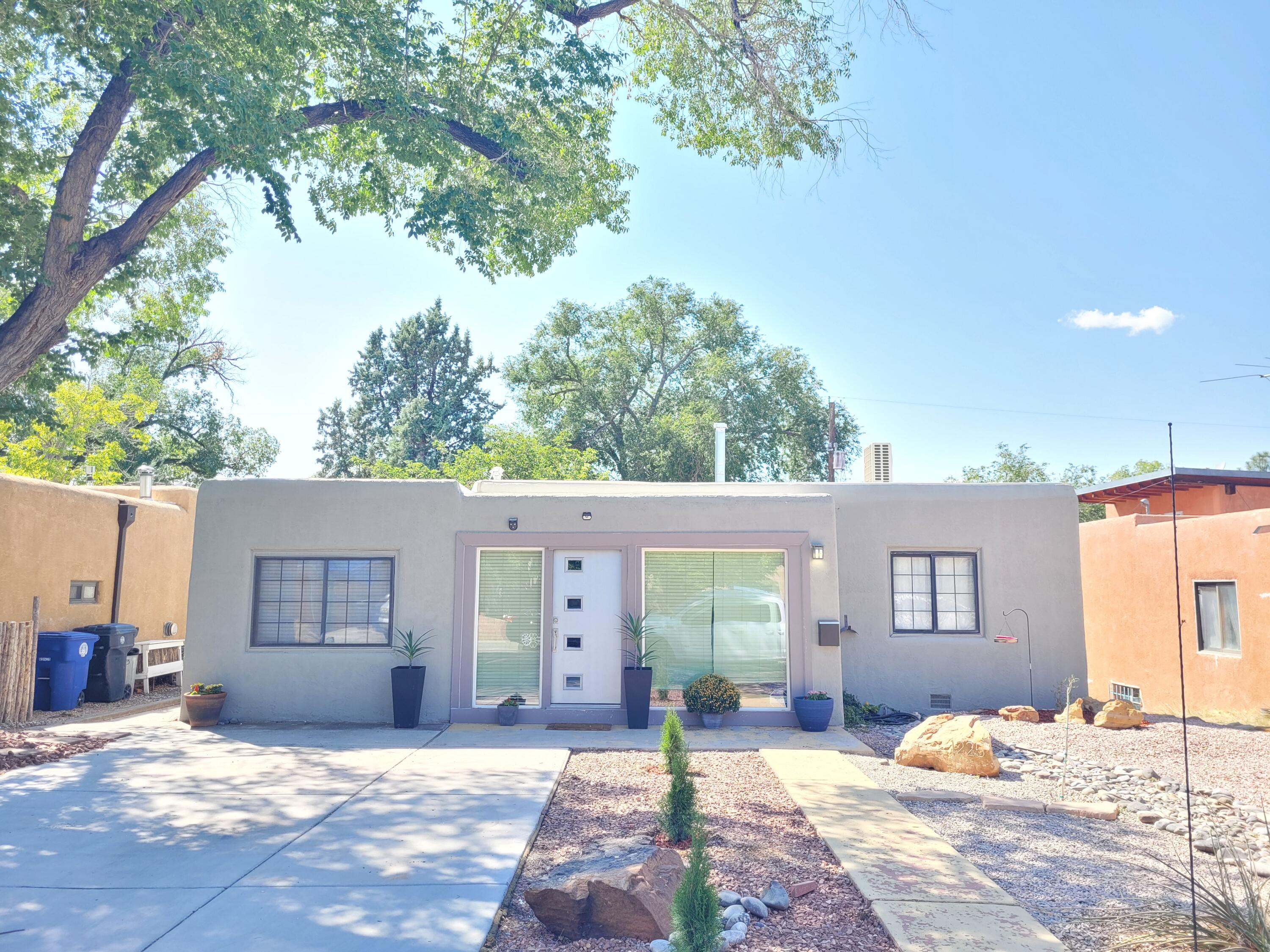 Main House: 3 bed, 2 bath, 1581 sq/ft.  Casita: 1 bed, 1 bath, 460 sq/ft. Casita was built in 2020 and is permitted. The property is an active Vacation rental, booked most of the time. Great location near UNM hospital, golf course, Nob Hill. Live in one, rent the other, rent both, or its a Great Multi-generational property.  Some updates: Upgraded electrical 2019, TPO roof 2019, Mini Splits, 5 heads Jan 2021, Solar- OWNED 2019, Full bathroom 2018, Entrance windows and door 2019, Tile floors in kitchen 2019, Stainless steel appliances 2020. Lots of natural light, beautiful wood floors and cove ceilings. Easy to maintain xeriscape yard. The Casita has its own separate entrance, a living area, bedroom, laundry room, bath, and kitchenette. Built in 2020 with metal roof and refrigerated air.