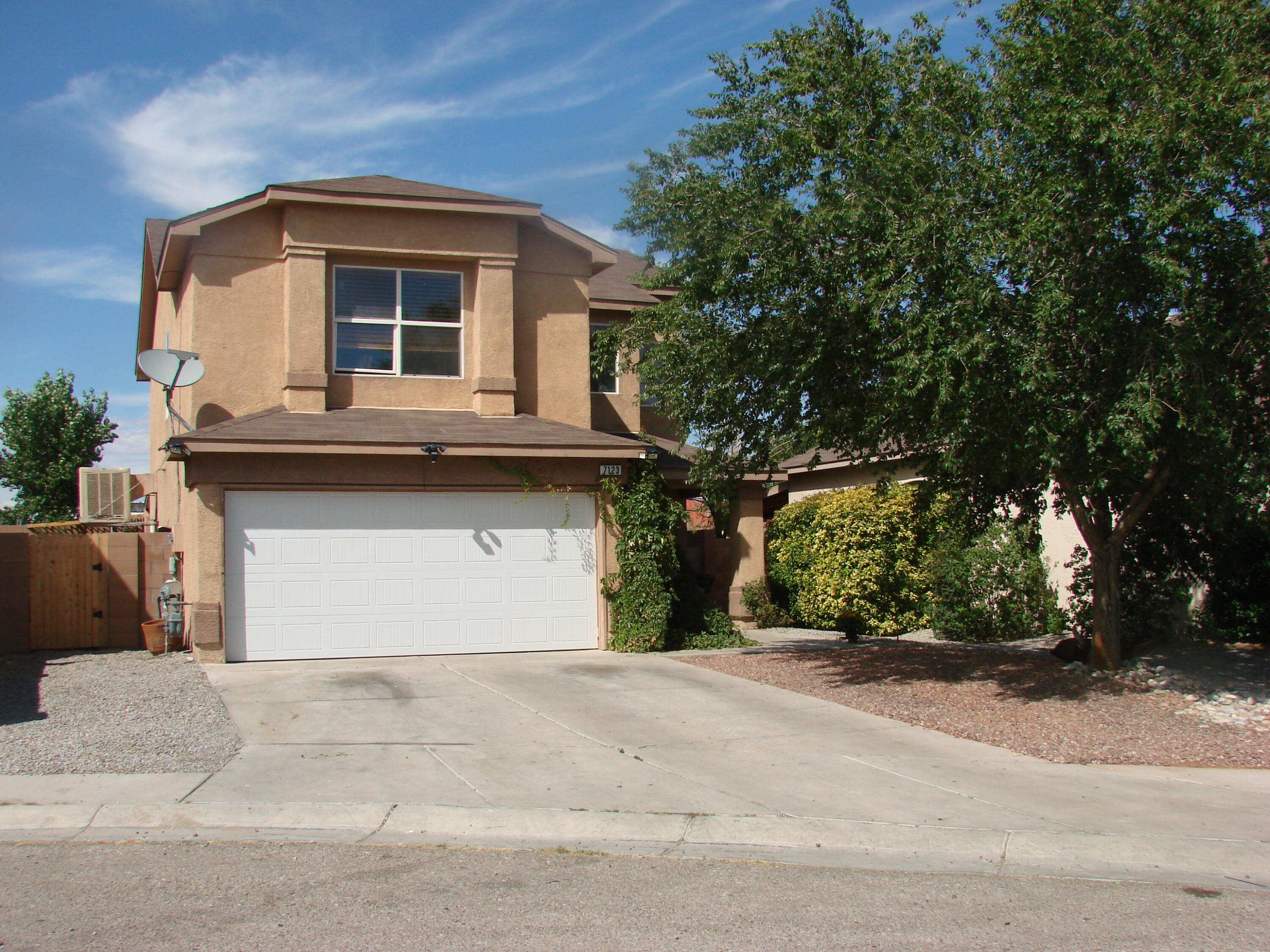 Location! Location! Location! This 2 Story Home sits on a Quiet South Valley Street and has a Gorgeous Floor Plan, Beautiful Living Room with Pellet Stove/Fireplace and Custom Ceramic Tile Accents throughout.  Cozy Open Kitchen with Spacious Dining Area, 4 Spacious Bedrooms located on upper level with Walk in Closets and Ceiling Fans. Low Maintenance Backyard Patio has a Huge Custom Fireplace and is perfect for Barbeques and Family Gatherings. Brand New Garage Door. This home will not last Long and is ready for Someone to make it their own!