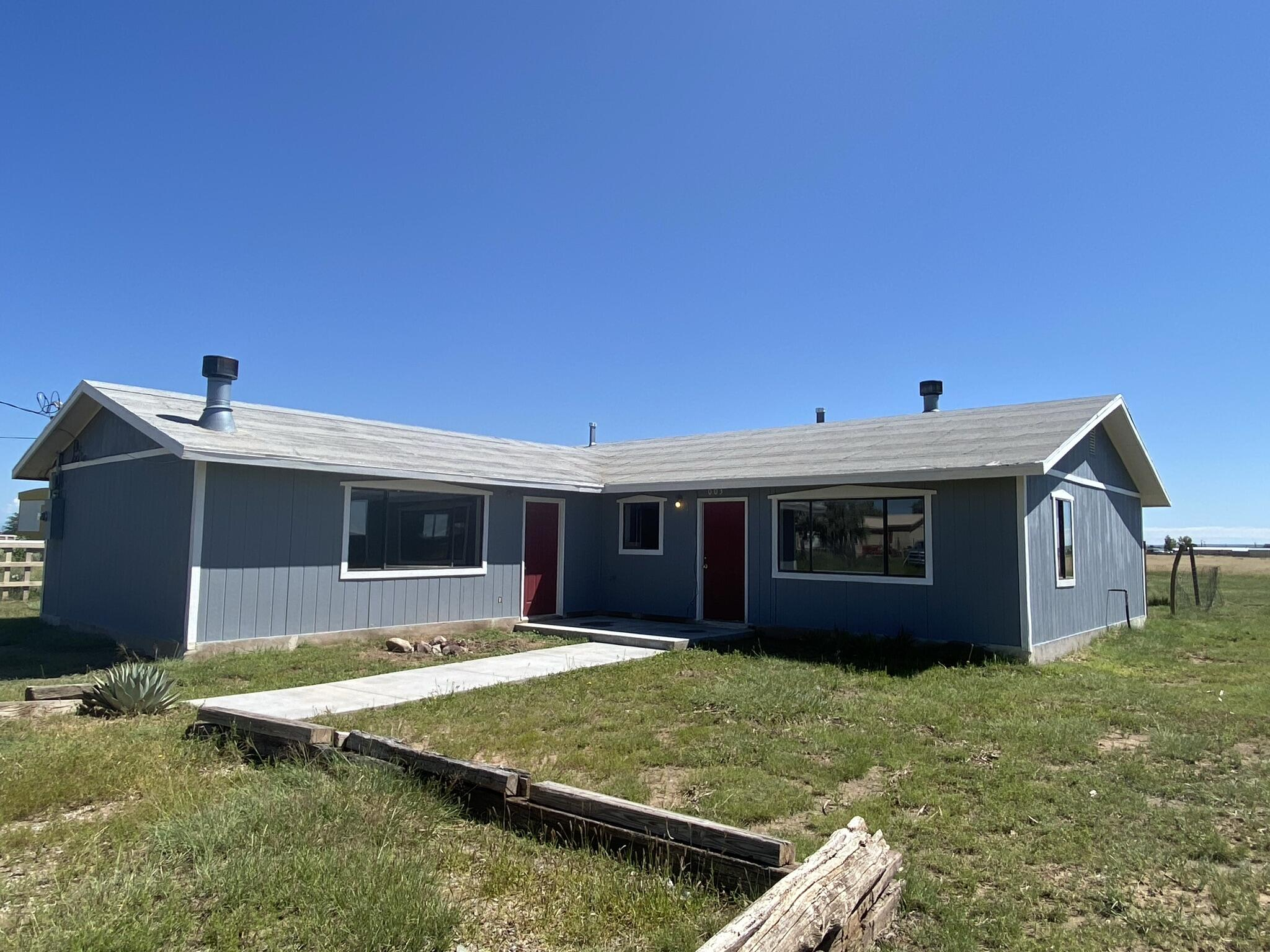 Moriarty, NM site-built home on a half-acre lot is now available.  This home is 1613 square feet, with 2-living areas, 3 bedrooms and 2 baths. Both living areas have wood burning fireplaces. Seller has installed new flooring throughout and fresh paint inside and outside.  A new shingle roof will be installed soon. This home is ready for you to occupy. Albuquerque in less than an hour and Santa Fe right at an hour.