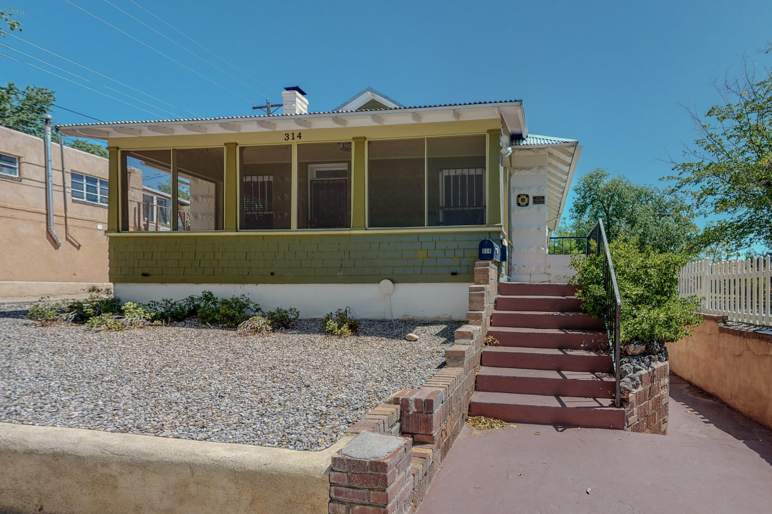 Beautiful historic home in UNM with finished basement apartment on huge double lot! Main house welcomes you large screened in front porch. Hardwood floors throughout, bright and open living room with gas fireplace. Dining. room leading to galley kitchen with butcher block countertops. 2 bedrooms, jack and Jill bath with claw foot tub. Finished basement apartment with painted concrete floors, small kitchen and dining area, 3/4 bath and open loft style living/bedroom space. Detached 1 car garage all this on a huge double lot with potential to add additional units for added income. Zoned RM-L. The property is located directly across from Presbyterian hospital and could be a fantastic airbnb or furnished rental for traveling nurses or the film industry!
