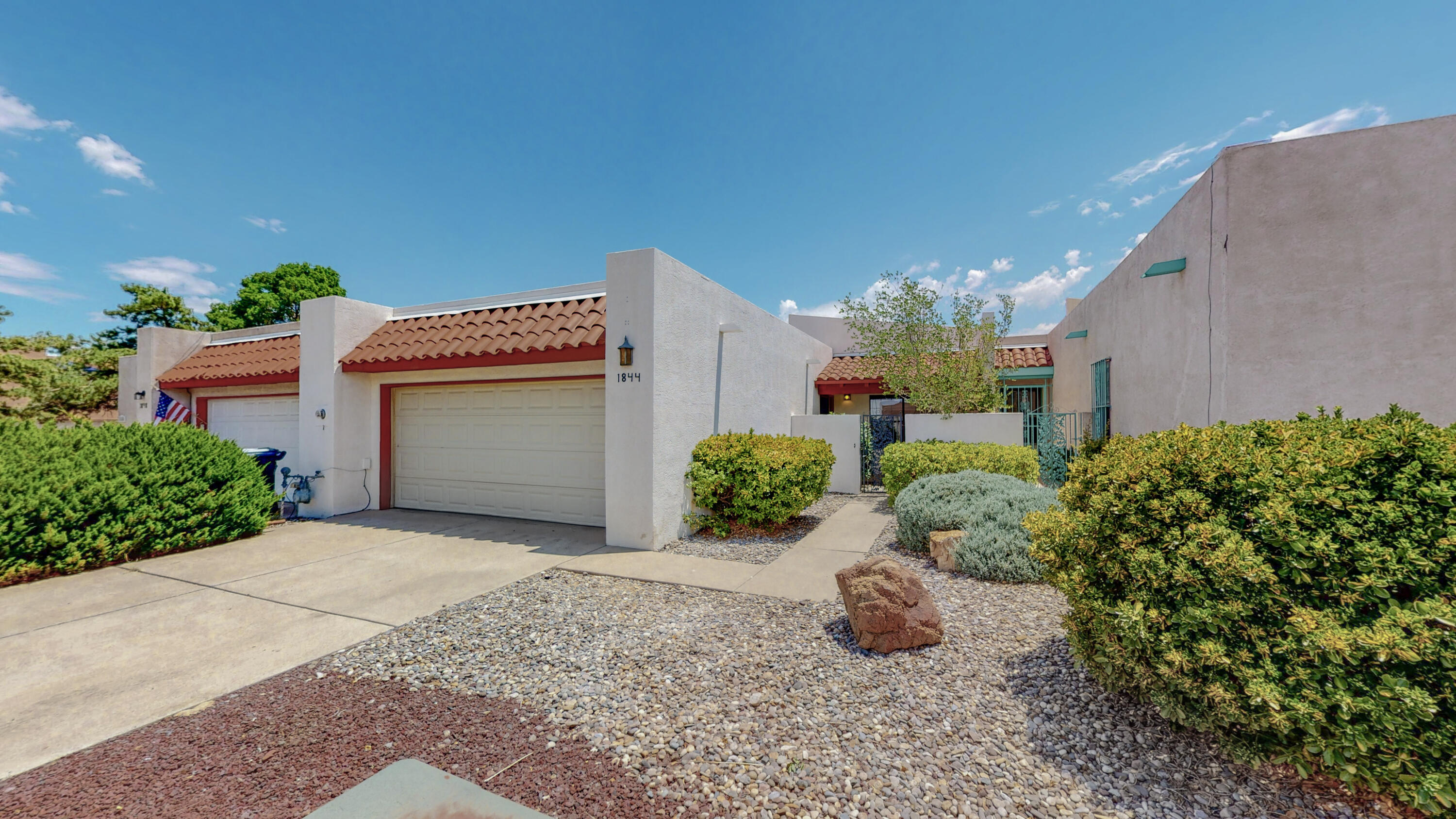 This Cozy, 3 Bdrm Single Level Townhouse w/ 2 Car attached Garage is Minutes from Whole Foods, UNM, Alb Tennis Club, Downtown, Hospitals, UNM Law & Med Schools! Enter the house Through a Private Gated Courtyard. High ceilings w/ Beam Accents, Kiva Fireplace & West Facing Windows give The Great Room an Open, Bright Feeling. Ample Kitchen Counter Space for all your Baking Needs. A Large Pantry & Laundry Room. Refrigerator, Washer & Dryer Stay! The Spacious Master Suite includes a Kiva Fireplace, Built in Book Shelves & Cabinets in the Sitting Room. Double Sinks & Large Walk in Closet Complete the Full Master Bathroom. Xeriscape Front & Backyard allow for Easy Maintenance. Covered Front & Back Patios. Hot Water Baseboard Heat.