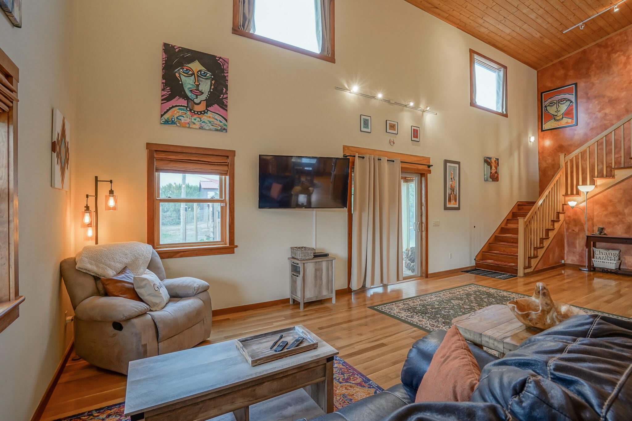 Motivated Sellers! This is a property you must see to appreciate! Custom-built home with thoughtful upgrades both inside and out! Beautiful immaculately kept 5.04 acres of land! This unique property is ideal for animal lovers and was designed by an architect who partnered with animal care facilities worldwide to set up 4 barns with electricity and water to allow best-in-class care for any animals you may have. Licensed professionals built every building with county permits.  RV-covered parking, two 30-amp and one 50-amp hookup. Beautiful 20ft pine ceilings in the main living area with attached sunroom. Kitchen has cherry pecan cabinets with a hard maple top. Virtual tour available! Ask your agent for a printout of the many upgrades to the home and further information about the property!