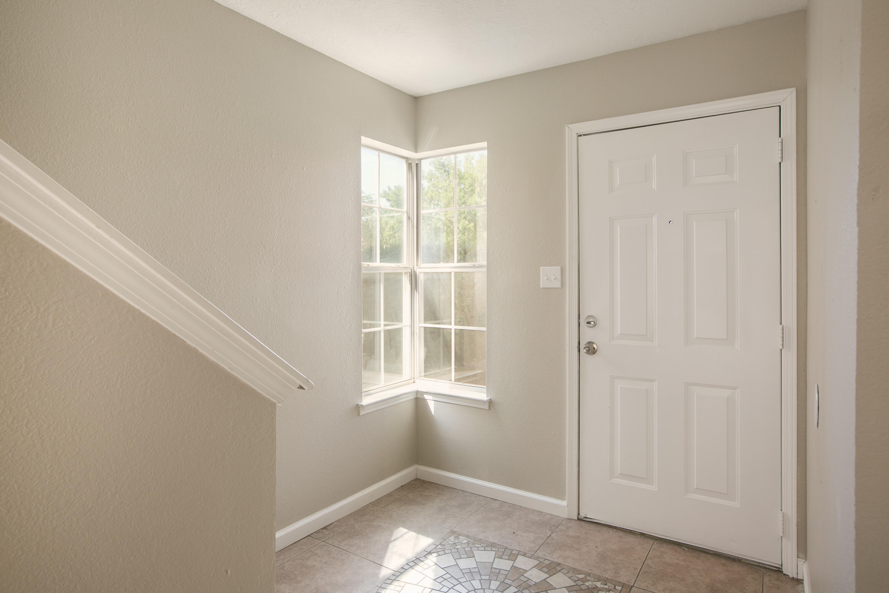 Updated Townhouse in the Northwest Heights with easy access to I40 and Coors. 3 bedrooms, 3 bathrooms and new interior paint. Updates include tile, carpet in the upstairs, Kitchen Cabinets w/ Oceania Quartz. Bathrooms have been updated with tile, vanities, and fixtures. 2 car garage, refrigerated air, walk in master closet, and more!