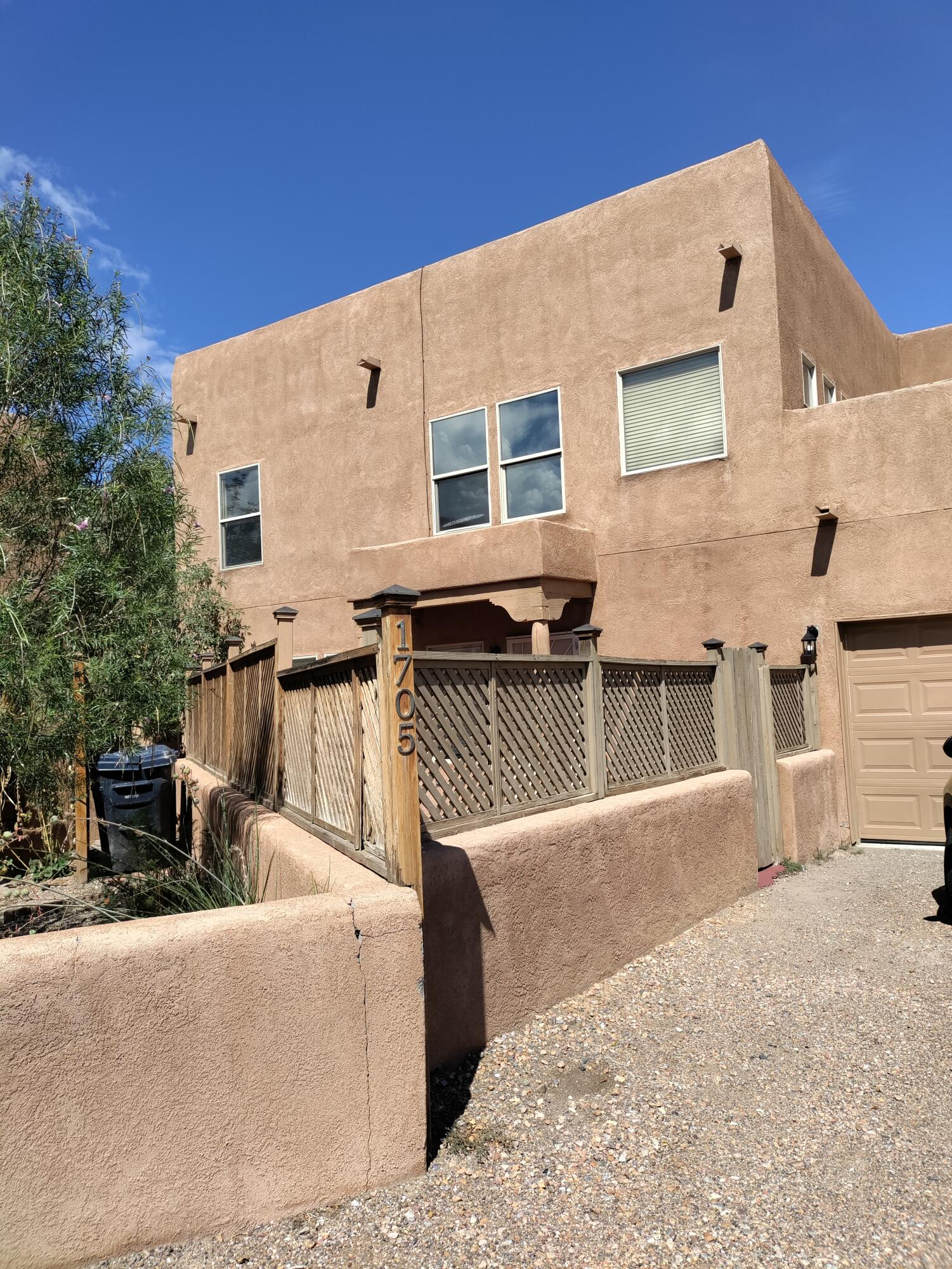 Wonderful 2 story Townhome nestled in the back of quiet North Valley Los Jardines Subdivision. Refrigerated Air, No Carpet, Laminate and Tile floors, Kiva style Fireplace, Ceiling fans, 3 bedrooms, 2 full baths and 1/2 bath down stairs. Kitchen has an Island  Come take a look .
