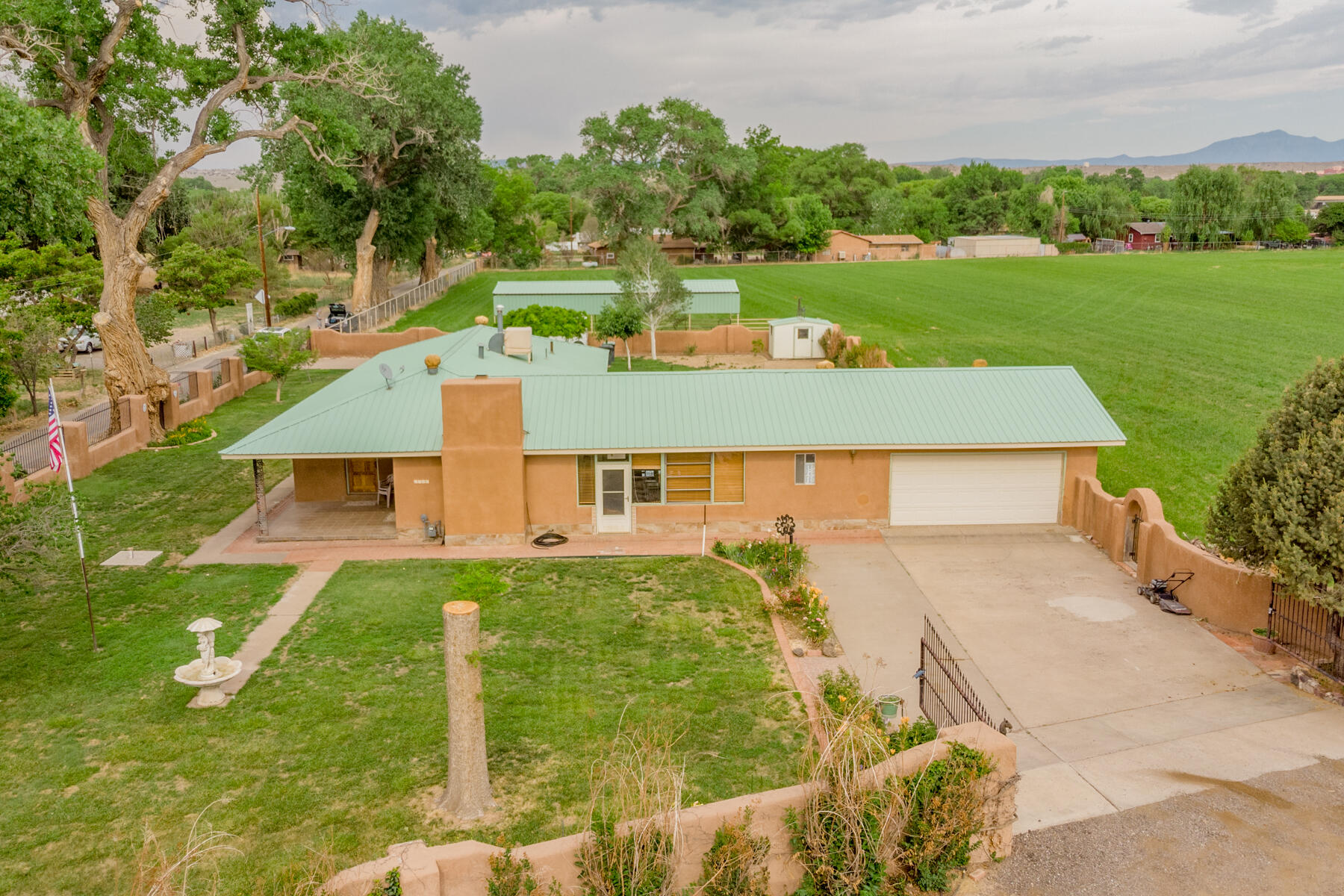 Come and look at this amazing property with 4.5 acres and with 1907 water rights and ditch access. Currently city water in the street. Using well water for home. This property has easy access to I 25. This property can also be accessed off the Malpais Rd. The possibilities with this property are endless. Book your appointment today.