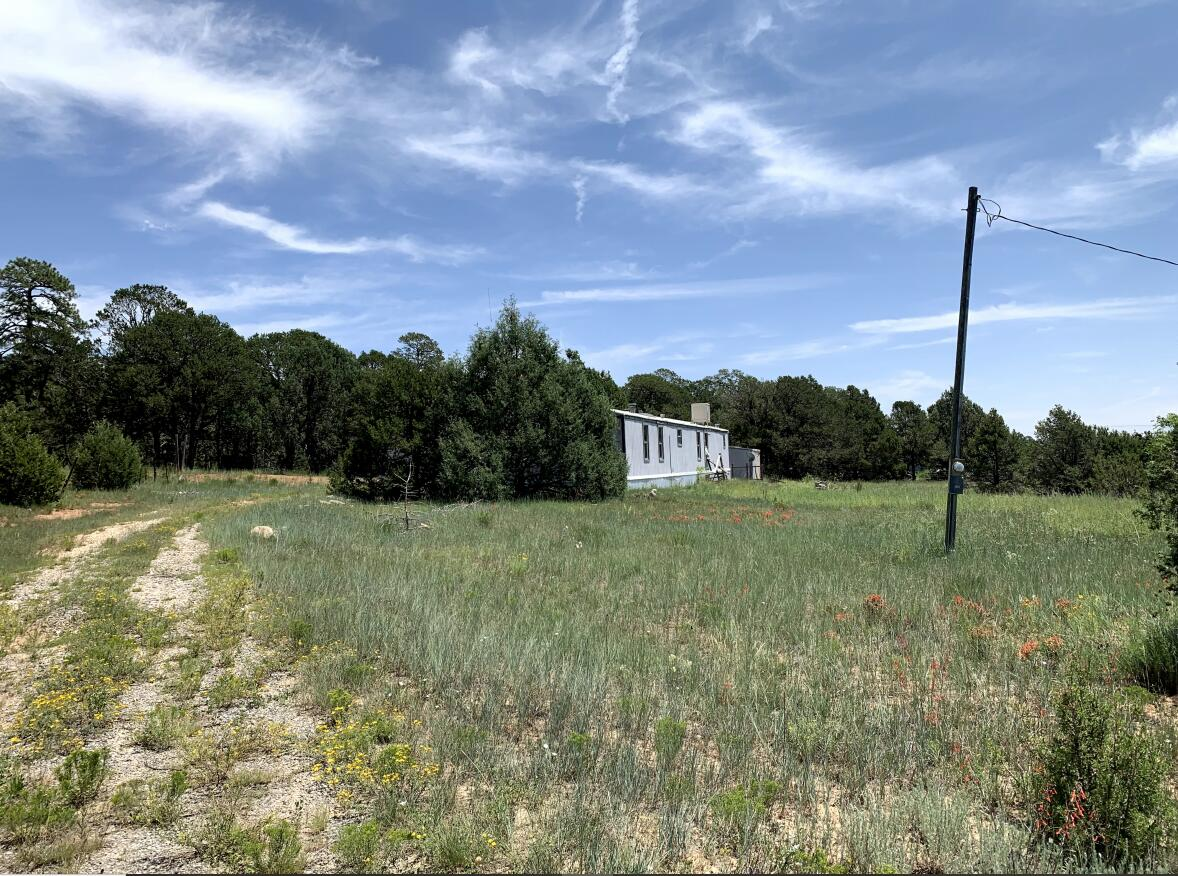 Beautiful 2 acre corner lot with utility hook-ups, near mailboxes. Community Water. Manufactured home is in need of replacement or extensive repair. Wear a mask in case of potential contamination.