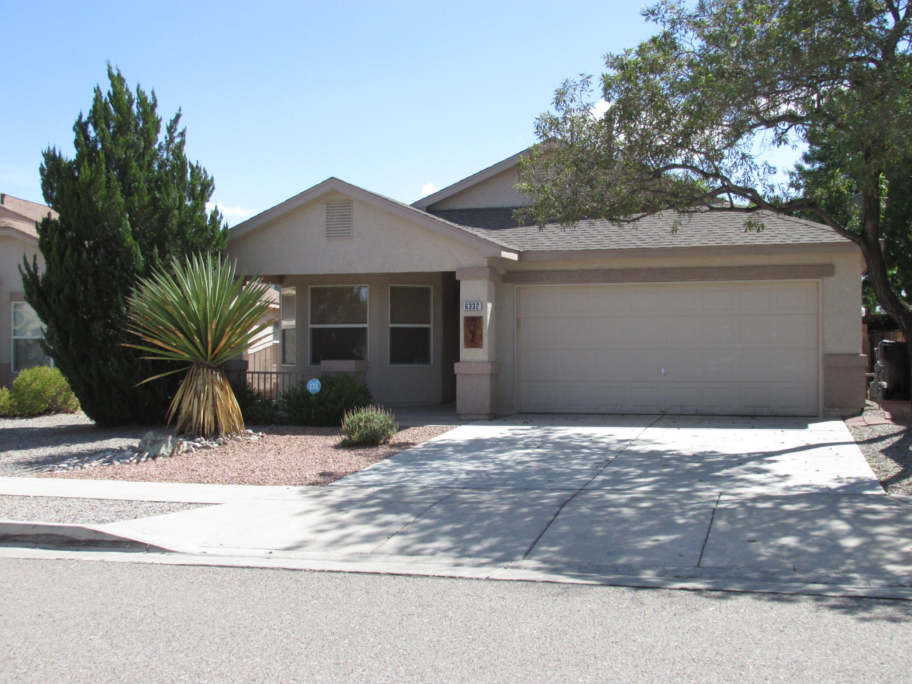 This is the house you will fall in love with! Clean and ready to move in, your future home has a green backyard with plenty of shade, grass, roses, covered patio, and inside there is only one level, two living areas, an alarm system, and the house smells great too!  Enjoy life in the backyard oasis with mature trees or relax inside in front of the fireplace!  So many features to appreciate in this DR Horton home such as accent paint, cultured marble tub surrounds, paneled doors, open kitchen floorplan, separate garden tub and shower, glass block, double sinks, a kitchen island, pantry, and cathedral ceilings!  Does this sound exciting?  You will be when you see this home in person.  Do it now, this will not last.