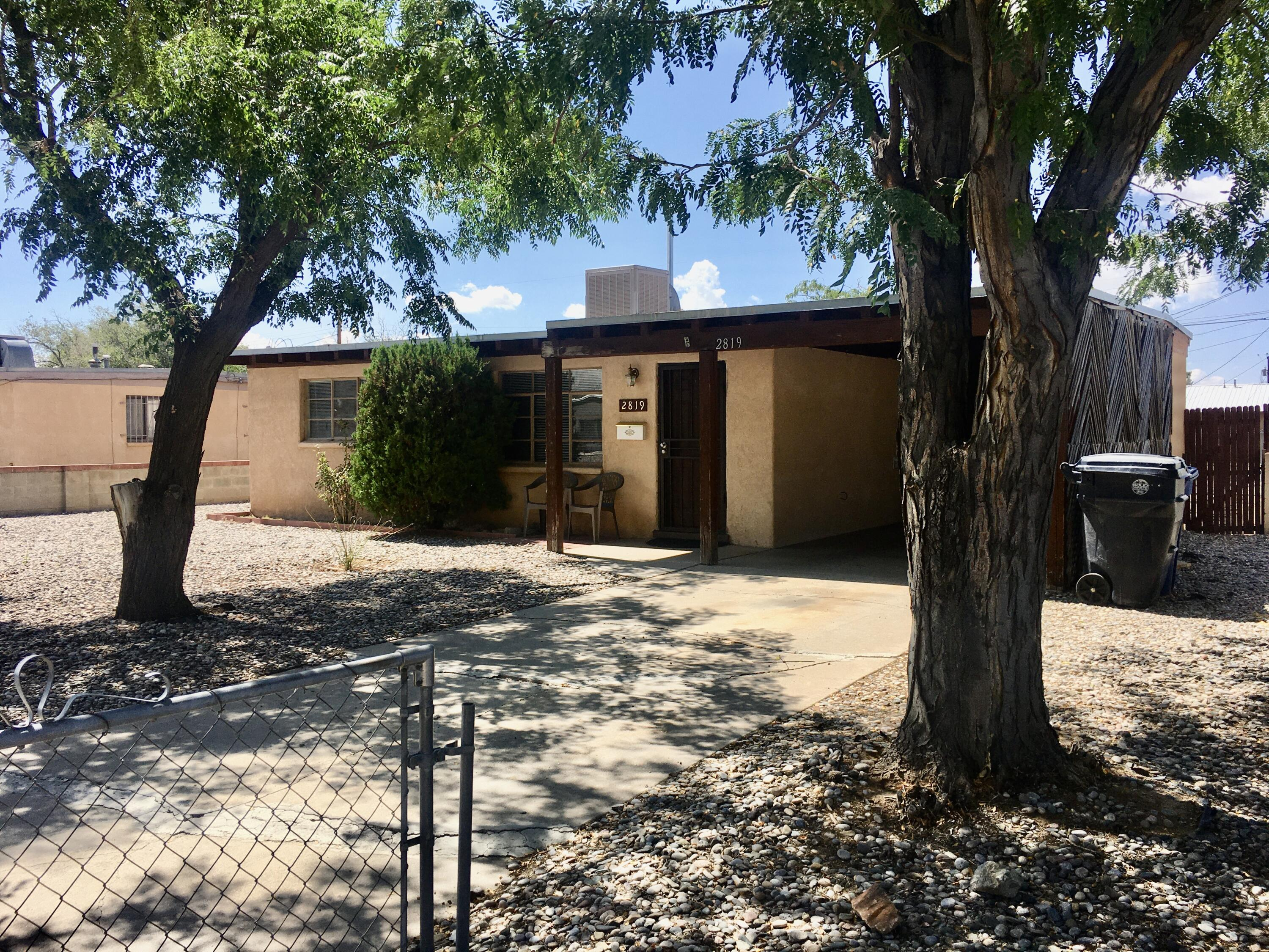 Don't miss out on the Uptown single story, NE heights gem! Once you open the front door you are greeted by gorgeous wood beams throughout the living room, kitchen, hallway and front 2 bedrooms. This home has possible backyard access and sits on a very large lot with a storage.building. Just minutes away from ABQ Uptown, shopping and dining, Coronado Mall, Movie Theater and I-40 access. Great Central Albuquerque location. A must see!