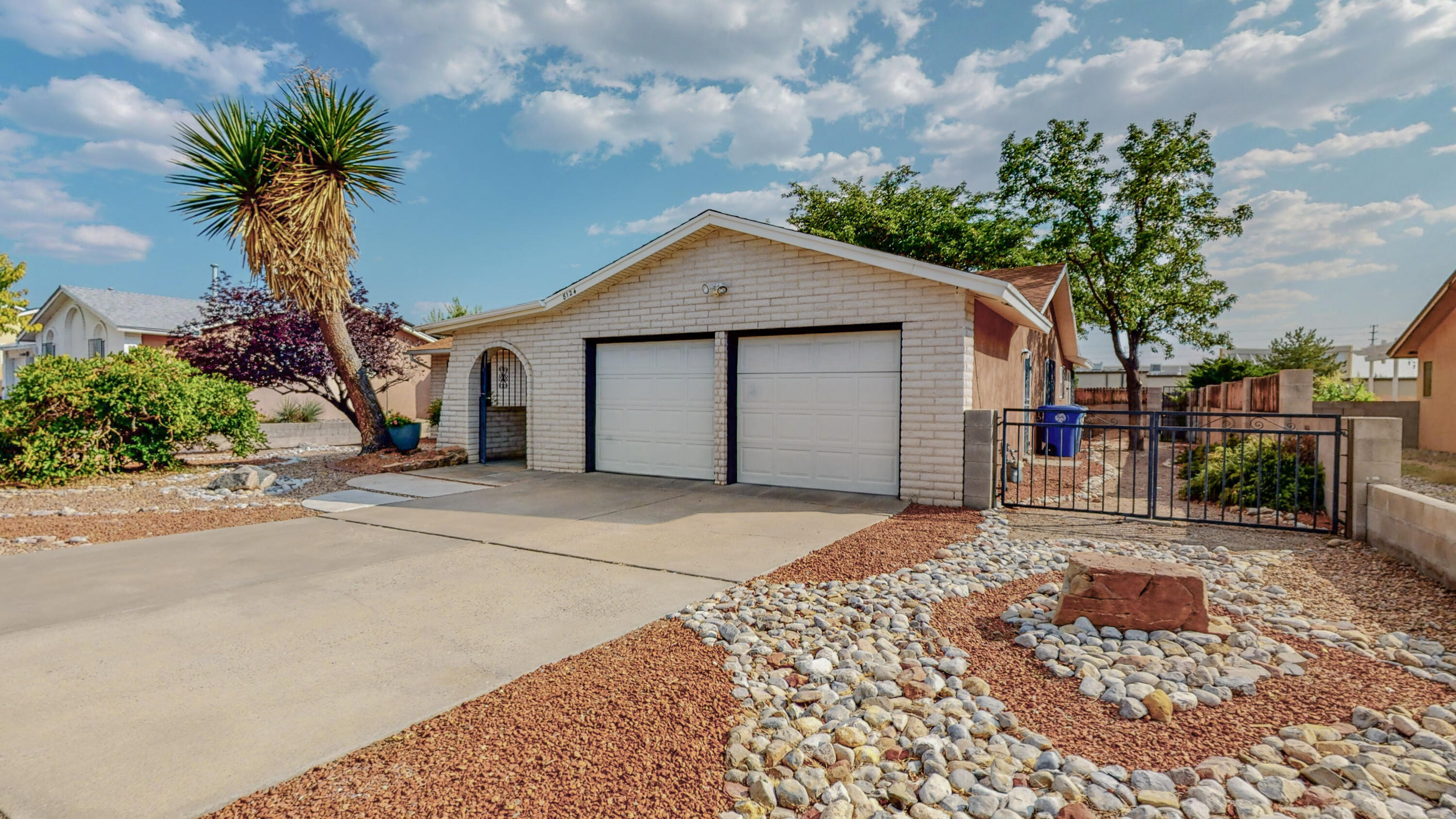 Great home in La Cueva school district! Fresh paint and newer laminate floors. Kitchen has been updated featuring Knotty Alder soft close cabinets, silestone counter tops and built in work space.  3 living areas with endless possibilities.  Close to shopping, parks, dining plus easy access to I-25.