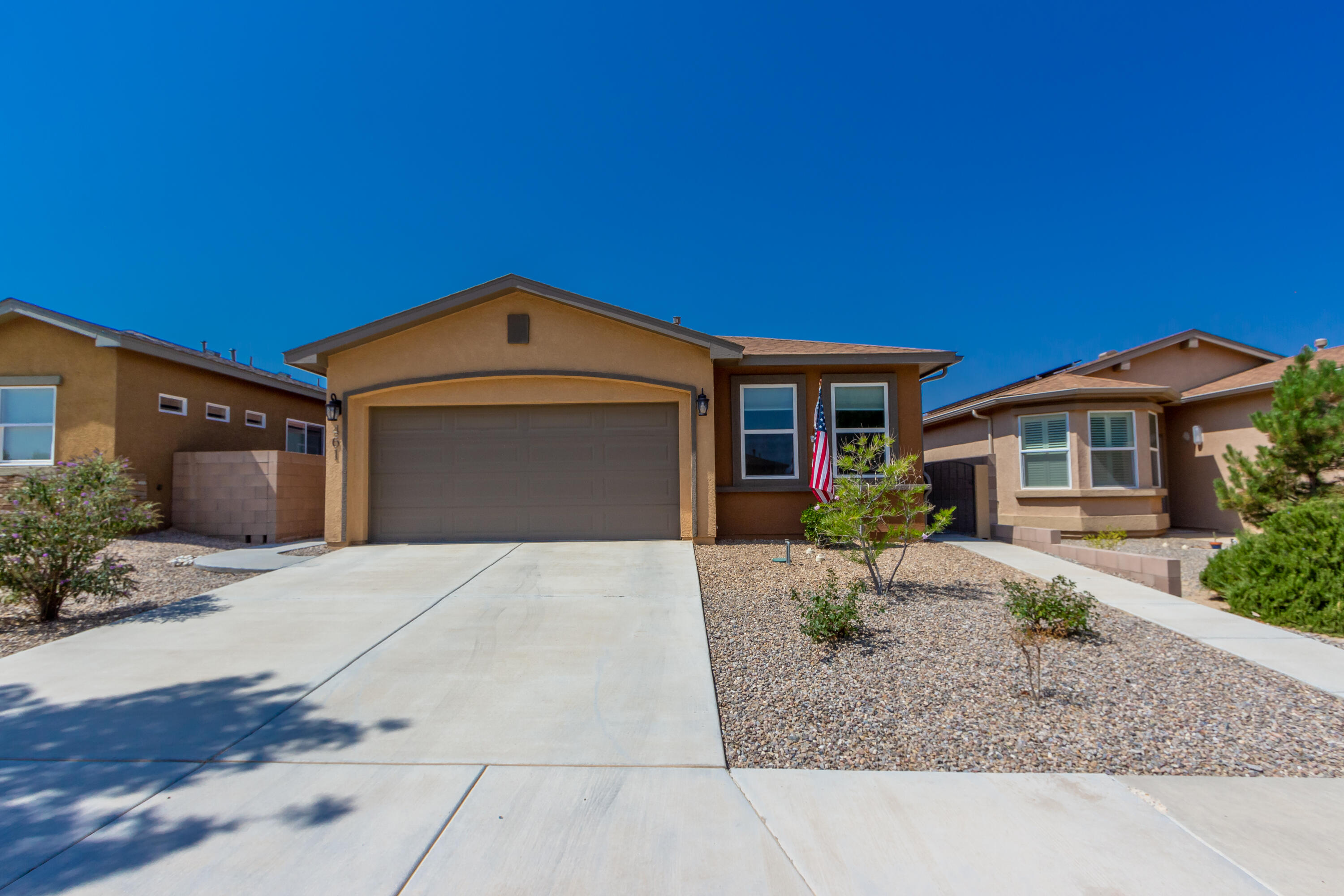 Super affordable 1405 sq. ft. home w/an extra sunroom for that little ''extra'' space. Sunroom is not heated/cooled but is comfortable year-round w/casement windows that open out. Completely landscaped, great window coverings & washer/dryer/fridge all stay to make it move-in ready w/no extra expenses! Charming side courtyard welcomes you...large kitchen island for extra storage & seating. Open plan w/split master & bedroom #2. Living room has beautiful easy-care LVT. Back yard is private w/views of El Cerro de Los Lunas. Walking path to clubhouse amenities is a great location to enjoy all the wonderful lifestyle perks of this award-winning Active Adult Community! Don't miss this affordable home...come see it today!