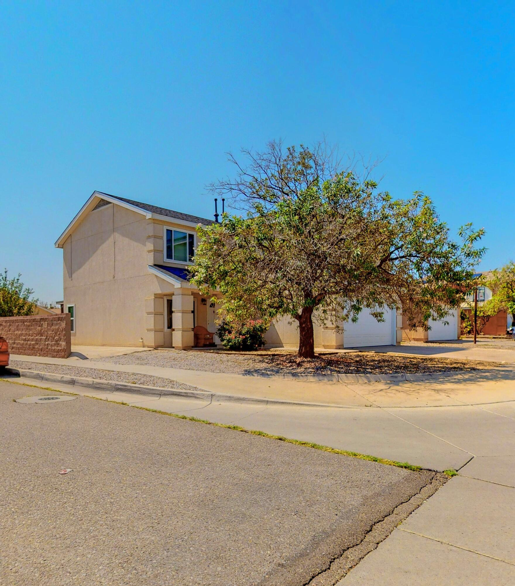 Welcome home to this well maintained, Sivage Thomas beauty! This home is situated on a huge corner lot, offers backyard access and a concrete pad for an RV or additional parking. The open floor plan offers a spacious living area complete with a fireplace, and opens to the sun filled kitchen with granite counters, and stainless steel range and OTR. Four generously sized bedrooms, plus a bonus loft perfect for an office/playroom or workout area. This home offers gleaming laminate flooring, tile in wet areas and new carpet in the bedrooms. Recent updates include fresh paint, A/C unit and windows. Enjoy the evening entertaining, or relaxing under the oversized custom covered patio. Home Sweet Home!