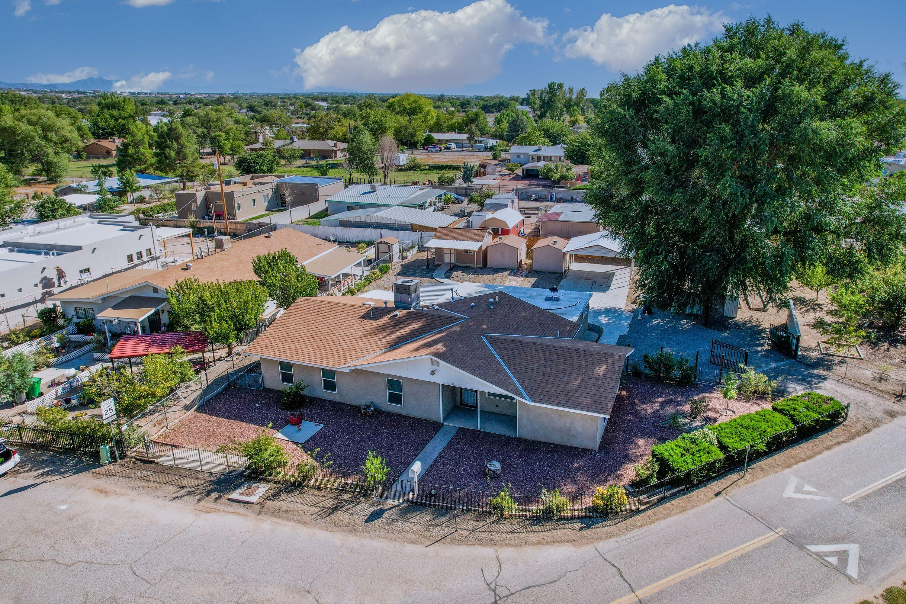 .45 acre lot in the North Valley!  Workshop and 2 additional storage units. Plenty of space with 4 bedrooms and 2 full baths.  Huge garden with fruit trees and an irrigation well.  Backyard entrance with a large carport!