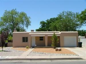 Pueblo Charmer! Hardwood Floors! Updated Kitchen, Granite Countertops!  Updated Bath! Cozy Kiva Wood Burning Fireplace! Thermal Windows, Nice private Back yard with easy care landscaping and large patio! Attached One Car GarageClose to UNM, Kirtland and Uptown!