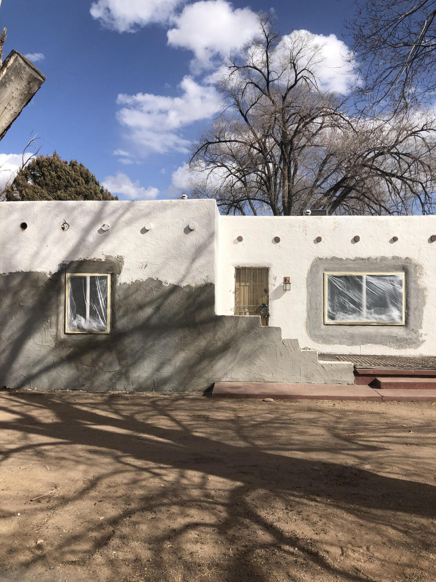 Experienced investors or Builder/ Flipper special.Due to unforeseen setbacks the seller is letting this property go ''mid restoration''. Amazing opportunity to complete this 3dr/3ba almost a century old partial Adobe. The hard work has already been done in the substantial clean out and addition of new vinyl windows and steel doors. Updated cabs - exterior stucco was Re-meshed and mud coated and just needs your choice of top coat stucco color. The  home sits on almost an acre and is currently zoned as R-1 with horses allowed, but would be a strong contender for rezonig as C-1 or SU-1 due to its prime location. Seller planned to subdivide the land into 2 more home lots with the unobstructed views at the back! The possibilities are endless with this much land at this low price!