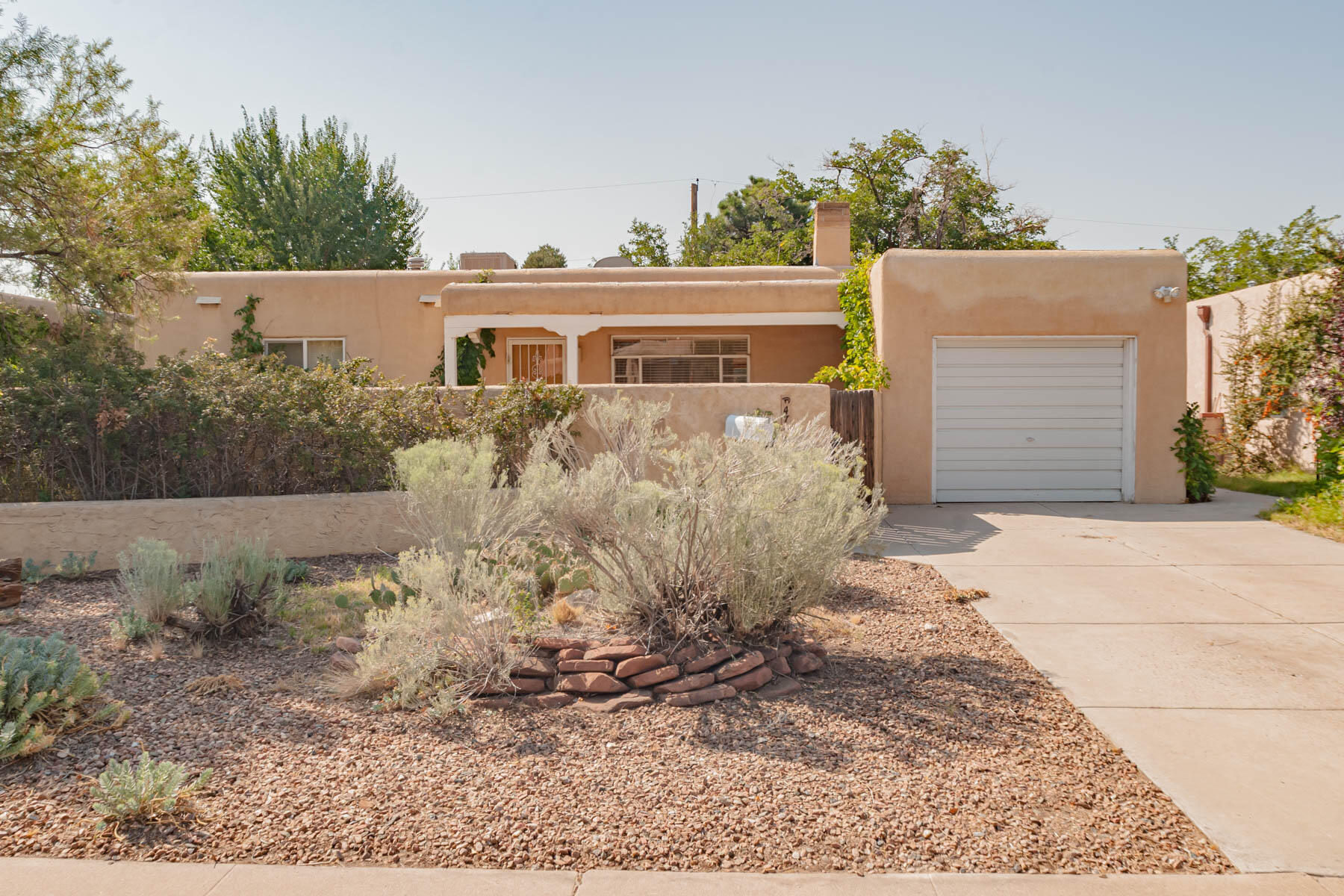 A MUST SEE!!!!!!   Charming sunlit pueblo style home with mature xeriscaped in the front courtyard.  Harwood floors throughout the home. Quaint kitchen with a dishwasher and nice counter space. Thermal windows in most of the rooms.  Pella wooden atrium doors in the dining room that led out the inviting backyard with covered patio.  Home located on a non-through street. Enjoy the beautiful mountain views from the courtyard. Comes with washer/dryer.