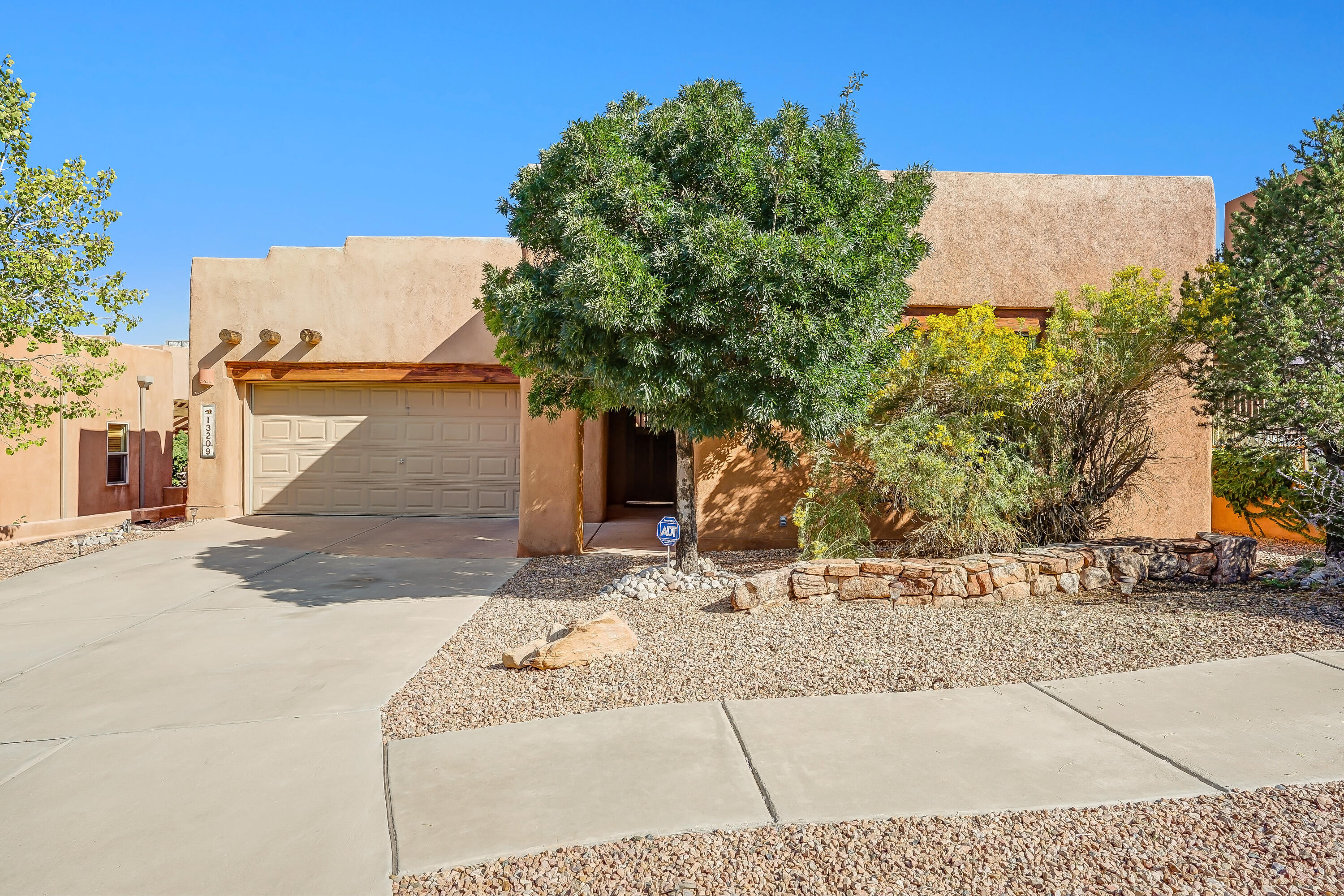 Check out the community pool on your way in or out!This beautiful High Desert home has 4 Bedrooms, 4 bathrooms, 2978 SqFt, and is perfect for entertaining with it's spacious kitchen, formal dining room, and two beautiful living rooms one that opens up to the backyard! The backyard is an oasis in itself with a pergola, well manicured landscaping and a peach tree. The private courtyard is also shaded with a large pergola with a quiet place to relax and a separate casita! Adobe kiva fireplace, custom doors, tile countertops are just a few of the amazing features this home has to offer. Master bedroom features stunning ceilings with traditional vigas, large master bathroom with double sink, separate garden tub and spacious walk-in shower.