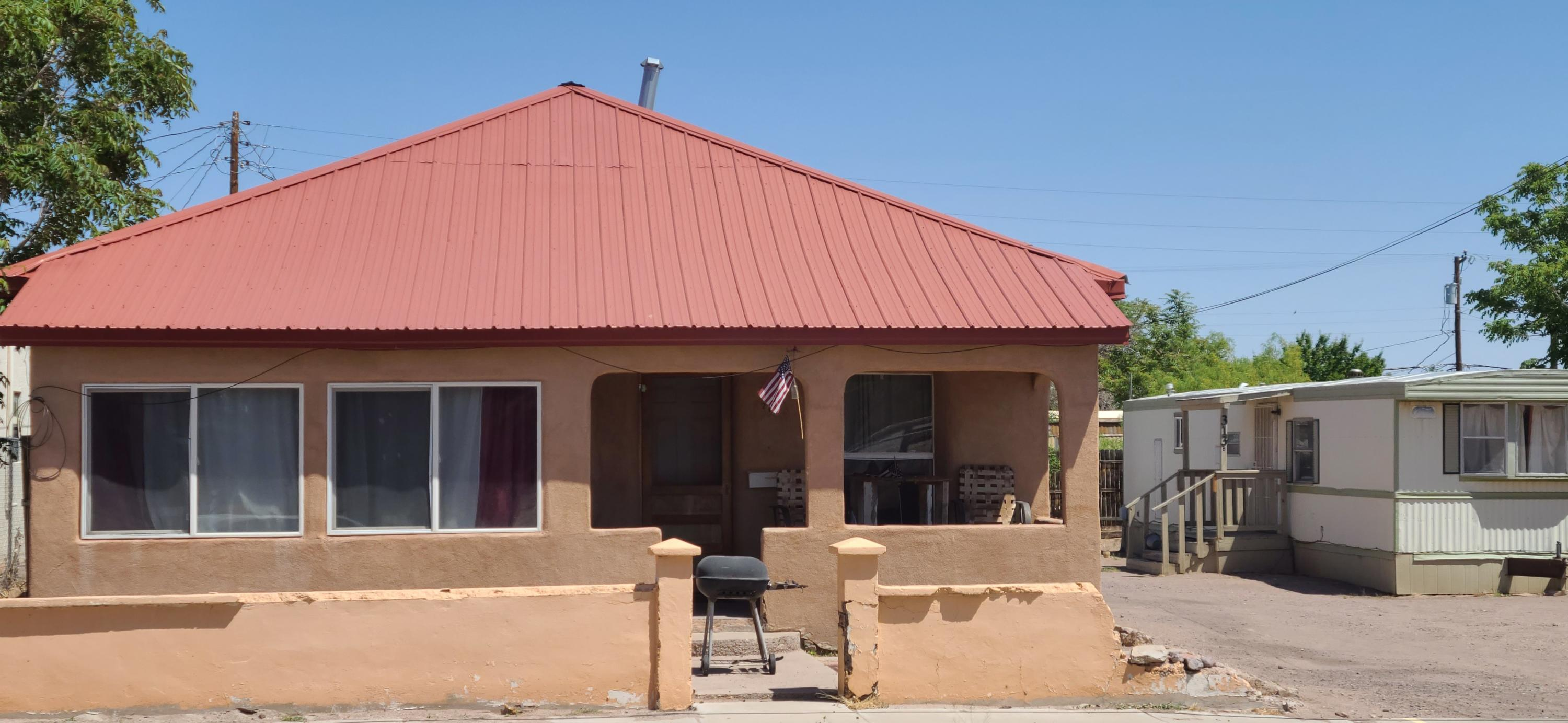 Two Bedroom, one bath near center of Socorro, NM with rental potential. MH will convey with property. Tenants in house and MH, 48 hour notice required for showings.