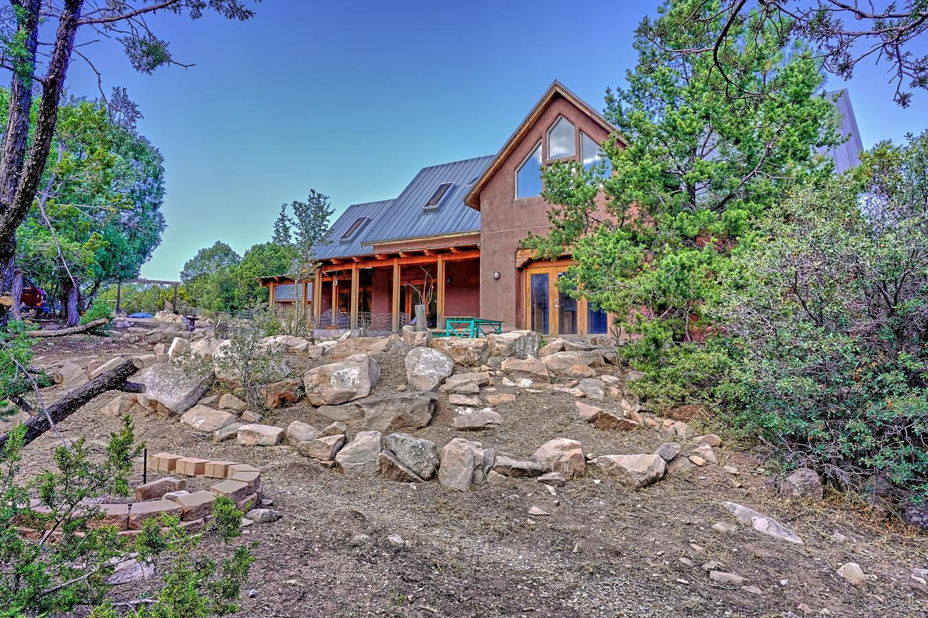 Mountain home with so much character!  Gorgeous exposed wood beam ceilings throughout, Saltillo and wood flooring! Beautifully remodeled kitchen! Gorgeous cherry wood cabinets, top of the line Thermador appliances! 5 cook top burner, steam convention oven, wine cooler, under-mount sinks, and beautiful granite countertops! Wood windows throughout, walk in pantry, huge mud/laundry room with in floor mud ''catcher'' Spectacular 2nd level loft (HUGE), open and lots of natural light!  4th bedroom upstairs with additional bath!Wooded and private lot!  Completely fenced in! Horse corral with tack/hay barn, chicken coop, and dog house/run area!  Detached 756 sq.ft  heated/cooled  studio/office, included in overall sq.ft. (plumbing started for bath),  2 car garage w/workspace & so much more