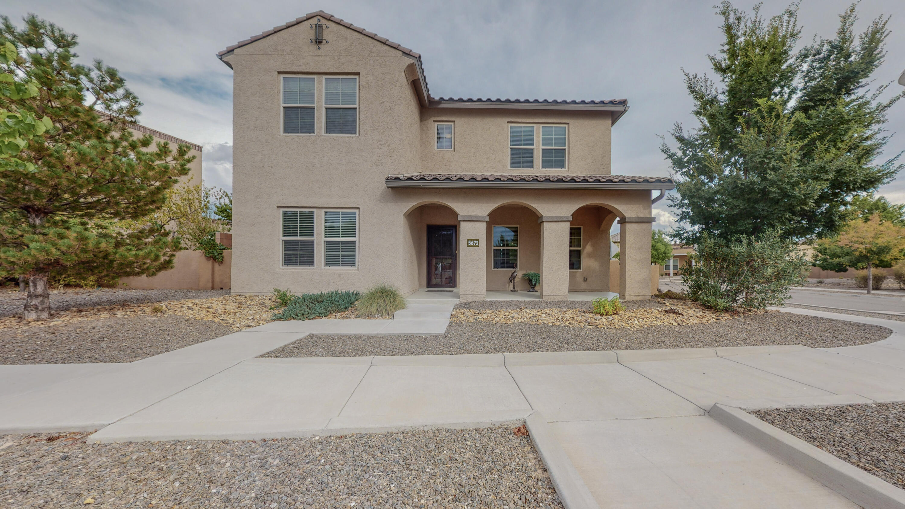 Live the Mesa Del Sol lifestyle! Enjoy the community pool literally steps from the front door. Beautiful open concept floorplan ideal for entertaining family and friends! Wrought Iron Spindle staircase adds class & elegance to the great room. Huge kitchen island with granite countertops, stainless steel appliances and 42'' cabinetry. Relax in your backyard with raised flower beds and rain barrels to water your garden. This picturesque community offers parks, walking trails, a dog park, a gym and the community swimming pool. Enjoy quick summer walk to your favorite concerts at the Isleta Amphitheater.