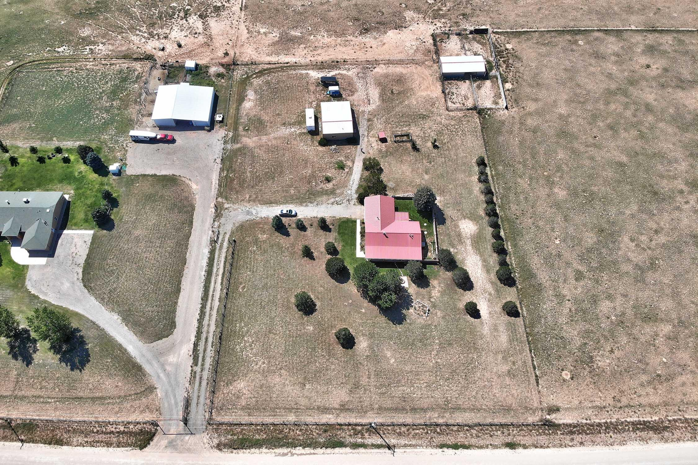This beautiful New Mexico horse property on 20 acres is in Moriarty with easy access to I40. Albuquerque is about 30 minutes away and Santa Fe about an hour. This property has it all for your family's dream home. The well (391ft) was drilled one year ago! New pump and new pressure tank! A large shop for 4 vehicles or a boat includes two roll-up doors and plenty of storage space for all you toys or equipment! The horse barn has storage area for hay,  plus stalls and a corral. Enjoy 3 bedrooms and 2 full baths, a large living and dining room and a open kitchen with breakfast bar. The landscaping is lovely with big trees and back yard is walled. The sun room is the perfect place to watch the sun go down over the Sandia Mountains.