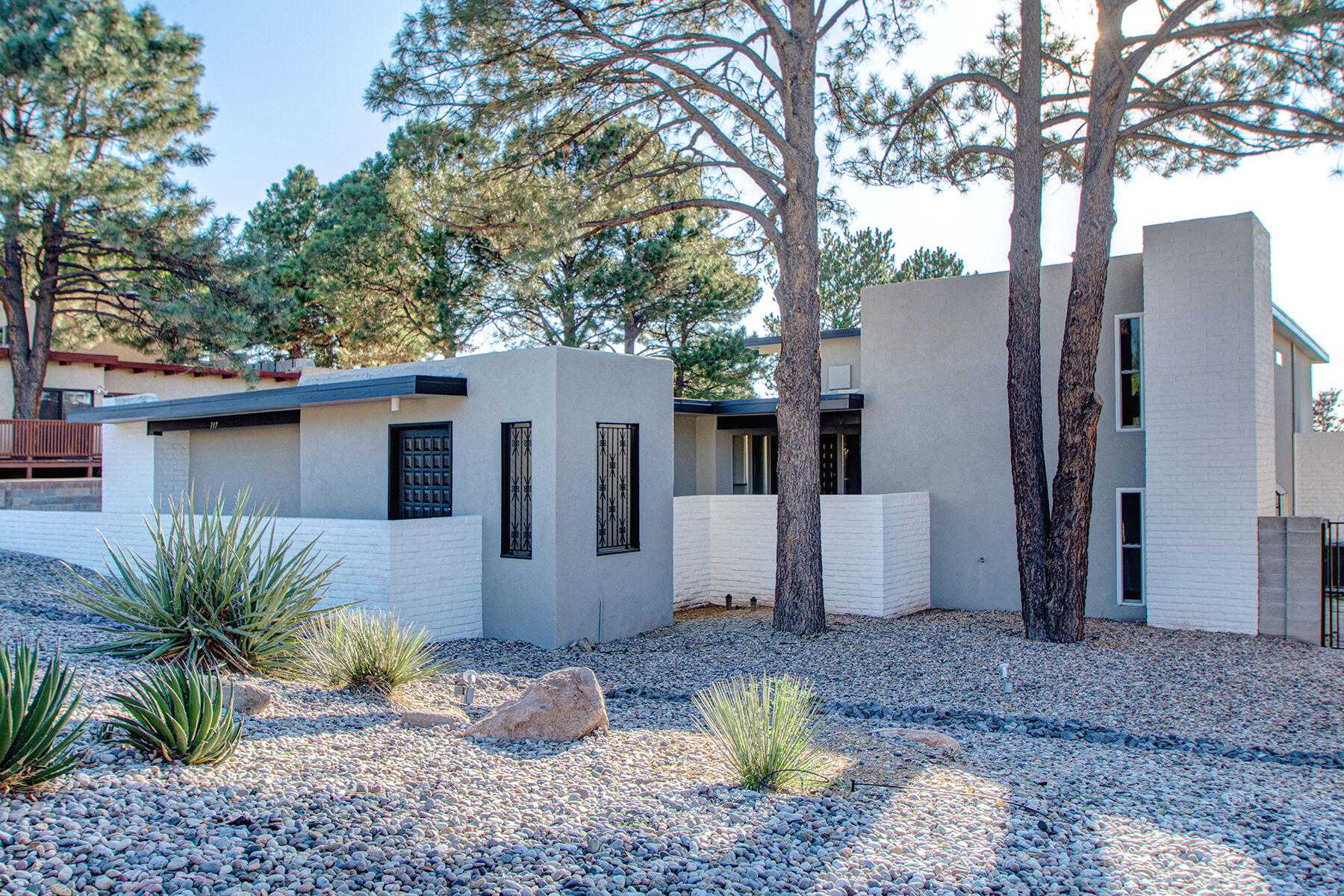 Incredible tri-level with 4BDR/2BA/2CG and lots of living space. Located in Albuquerque's Four Hills Golf Course Community. Enter through the courtyard and enjoy many updates throughout too numerous to list. Remodel is still in progress to be completed on 10/1/21. TWO living spaces - lots of natural light throughout. Updated kitchen with 6 burner gas stove & double oven, fresh paint throughout, fresh carpeting in bedrooms and stairs, flagstone flooring on first floor. Hidden wet bar, two wood burning fireplaces, two master suites, REFRIGERATED AIR, duct work replaced in 2017, laundry room near bedrooms, inground heated gunite pool, freshly landscape with rocks, large turf yard and mature trees for shade. Very minimal yard maintenance. This one is not going to last!!