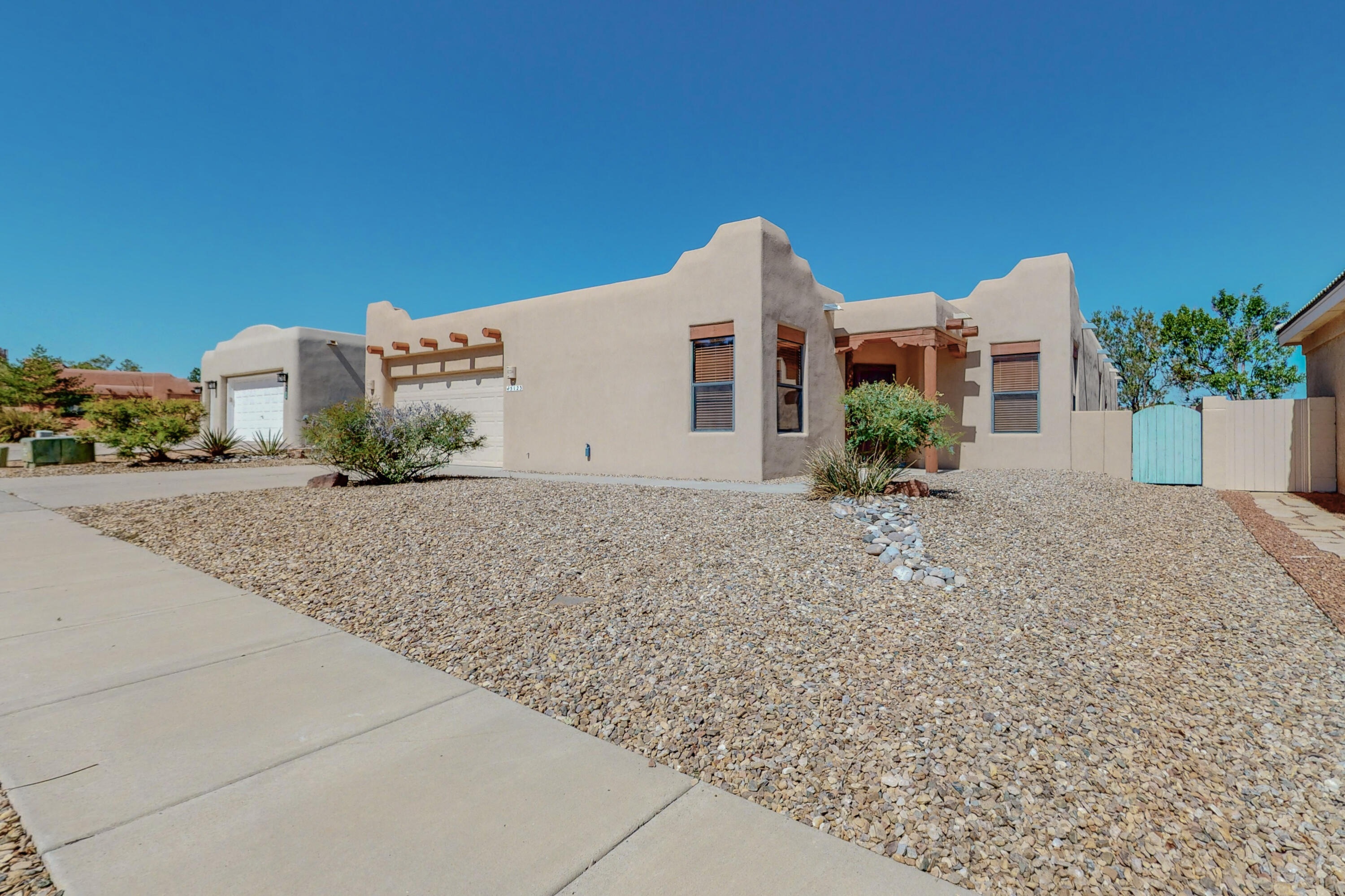 ***PRICE REDUCTION*** Make this custom southwestern gem located on a quiet cul-de-sac your new home! This 4bed/2bath home features a raised viga & latilla ceiling, corbel & adobe accents, and a gas kiva fireplace. The split bedroom design allows for master bedroom privacy. The solid wood doors, maple cabinets throughout, Italian glazed tile & custom designed security screen door reflect the quality of construction. The two fully enclosed storage areas located in the garage leave plenty of space for parking. The low maintenance back yard backs to open space. New evaporative cooler with an upgraded 3/4-ton HP motor, newer roof (2017), and stucco (2015). Make this house your HOME!
