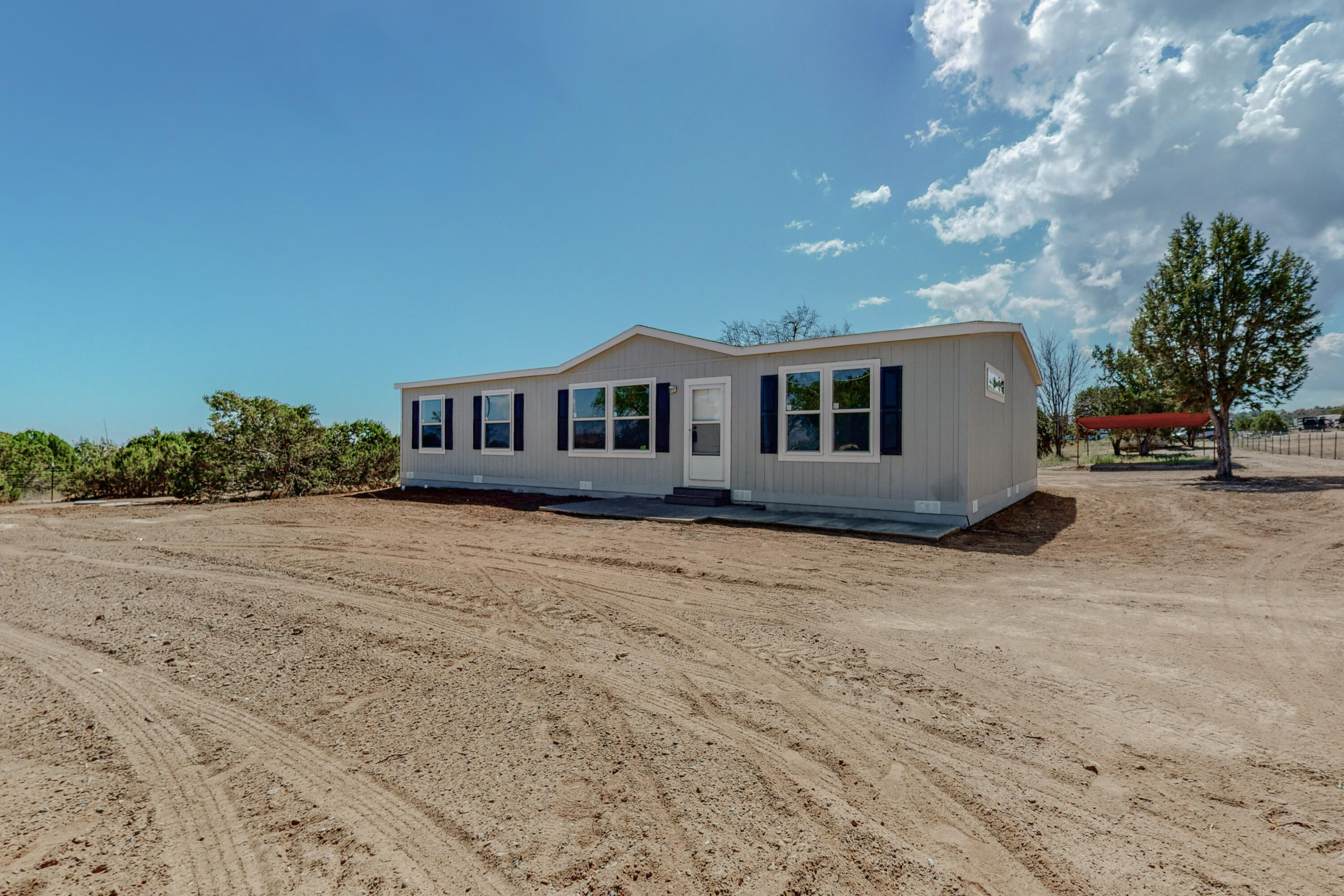 BRAND NEW, Gorgeous Cavco MF Home on just over an acre, completely fenced, 2 Storage Sheds, Underground Root cellar, Carport. Permanent Ground Set Foundation, Ready for financing.  Open style floorplan with Large Island in the Kitchen and a huge pantry. Master Suite has beautiful bath with Spacious Closet. Right in the Heart of Edgewood.  Just off the pavement.