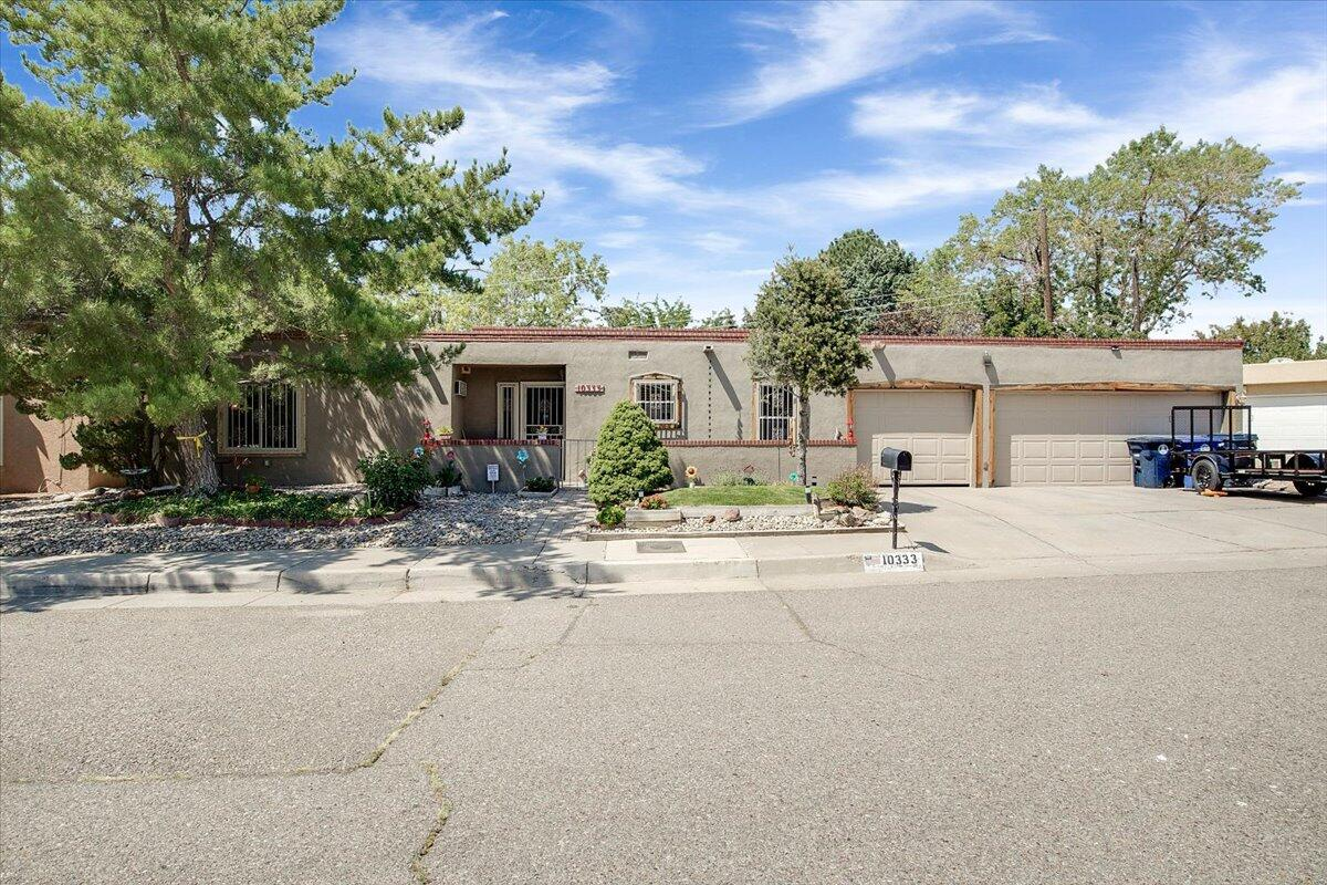 This fantastic patio house is ready for new owners to make this one HOME! 3 car garage is a BONUS!  This home is located in the heart of the NE Heights with close proximity to schools, shopping, and parks. Also comes with transferrable lifetime warranty on windows!  Check it out today!