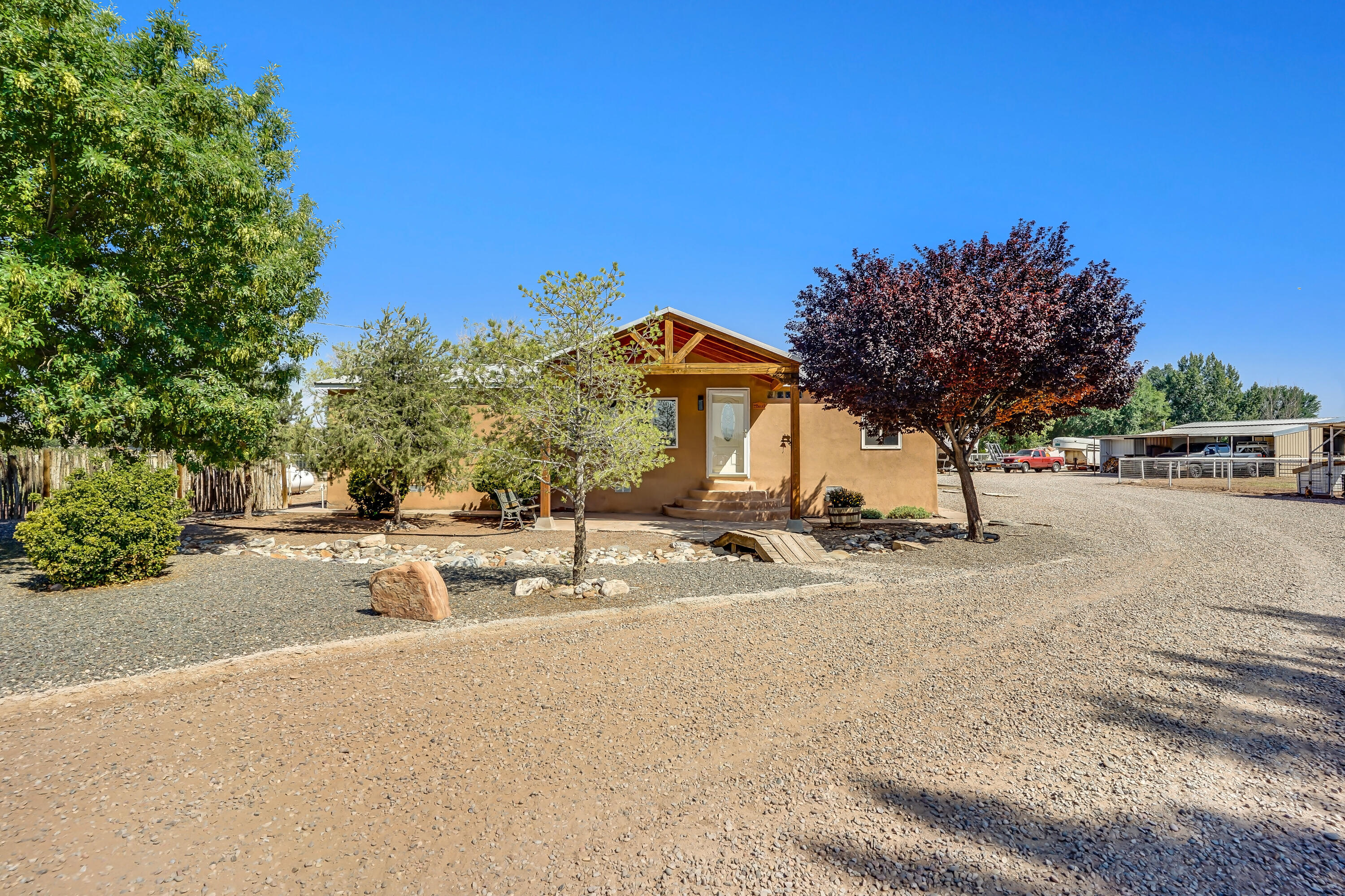 Wow!Country Living at its Best...Beautiful Views Of Tome Hill & The Monzano Mtns Country.This MiniRanch is equipped w/2 Properties,Barn,Irrigation Rights,New 198 ft Private Water Well Drilled 2020,Large Pasture,Extended 2 Car Garage,2 Storage Sheds,250-gal Propane Tank & 2 Entryways.The 1.5 Acres is perfect for Agricultural Farming,Raising Livestock,Subdividing...the Possibilities are Endless.Pick between 2 Beautiful Homes on the Pipe Fenced Property.Main House is 3BDRMS,2Bath 1,424 sq ft & Guest House is 1BDR,1Bath 642 sq ft w/ all the live-in amenities.Perfect for Parents,older kids,or Air-BNB.New updates include New windows,New flooring,Remodeled Kitchen/Bathroom,Huge Country Kitchen w/ Breakfast Bar,Metal Roof on both properties.Country living Close To The Big City Amenities!