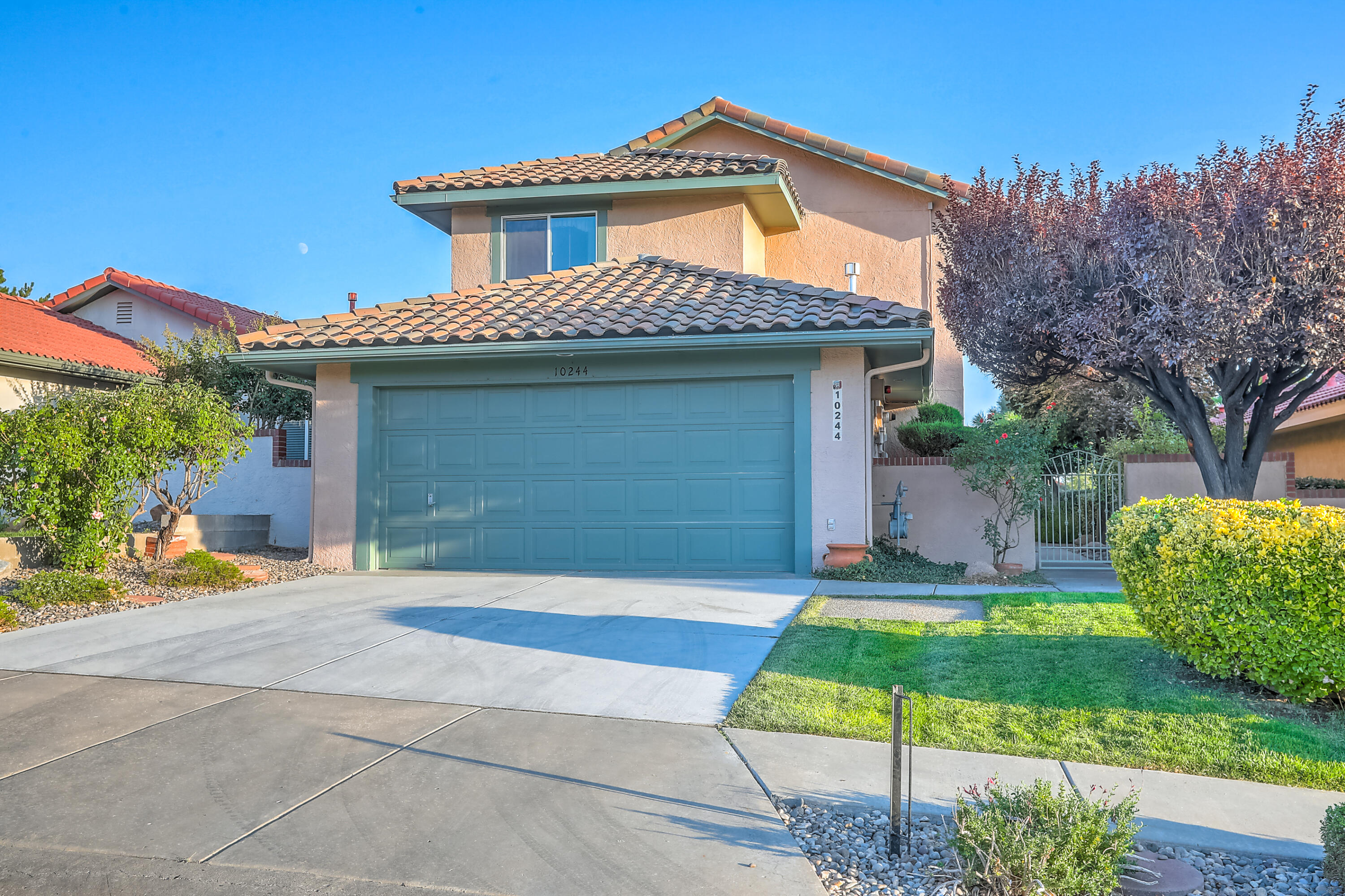 This lovely home is in the desirable northeast heights of Albuquerque. There is a light and bright 3 bedroom, 3 bathroom floor plan and the home has tons of updates.  Brand new stainless steel refrigerator and stainless steel electric stove.  New tile roof in 2018. Newer tankless hot water heater, furnace, windows, and there is Refrigerated air. There are 3 bedrooms and 3 bathrooms and all of the bedrooms are upstairs. The master has a full bath and a large walk in closet. In the kitchen you'll find a breakfast nook and a nice open concept to the 2 living areas with a cozy fireplace.  There is a nice courtyard entrance and a back yard with grass, trees, and a stairway up to a large covered balcony patio.  You can enjoy some great views and relax!